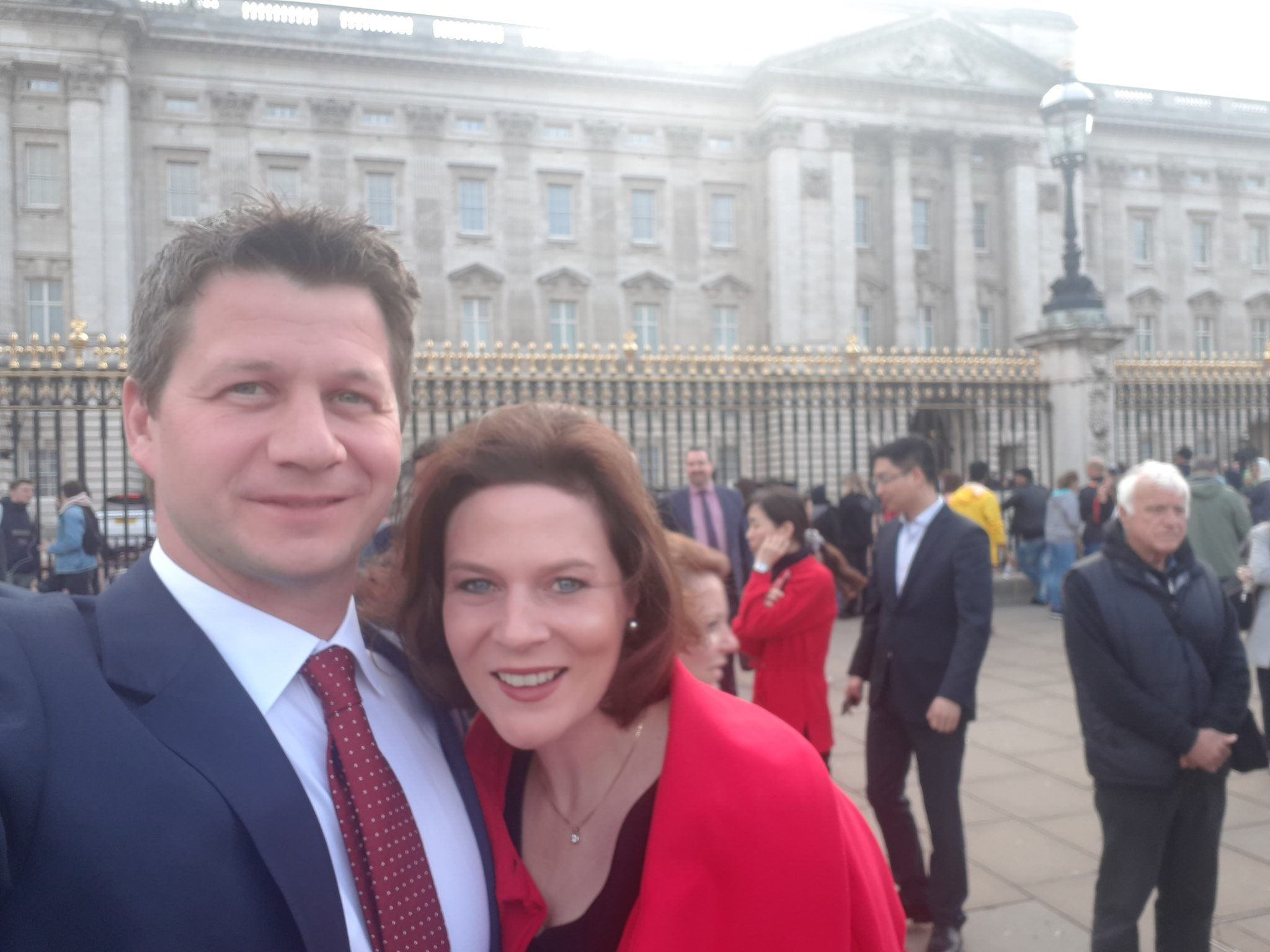 Above: Hannah and Jack Dale, co-owners of Wrendale Designs outside Buckingham Palace.