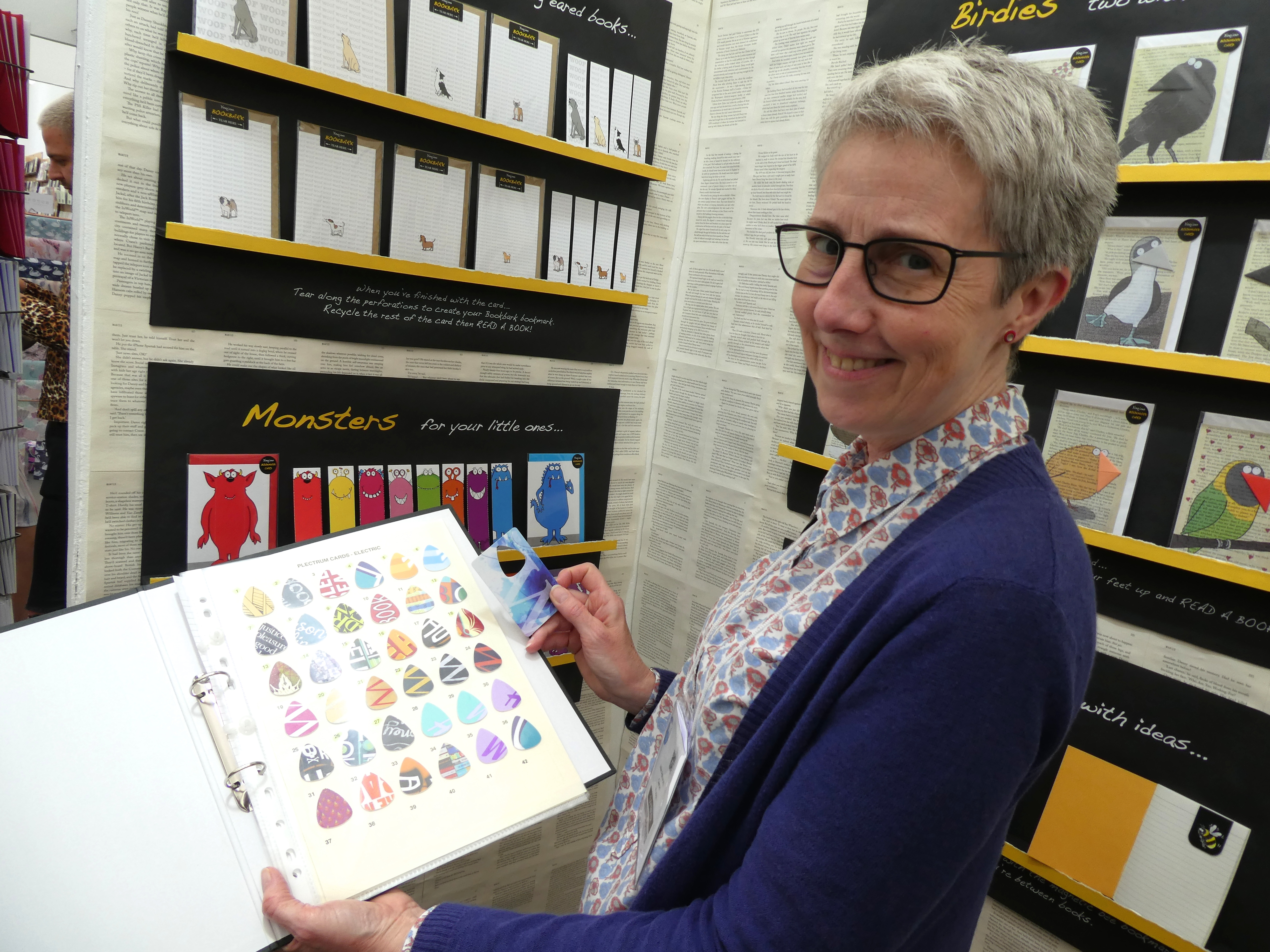 Above: Julie Ashworth on her stand at the recent Harrogate Home and Gift showing the array of plectrums that she has been able to cut from spent plastic gift cards.