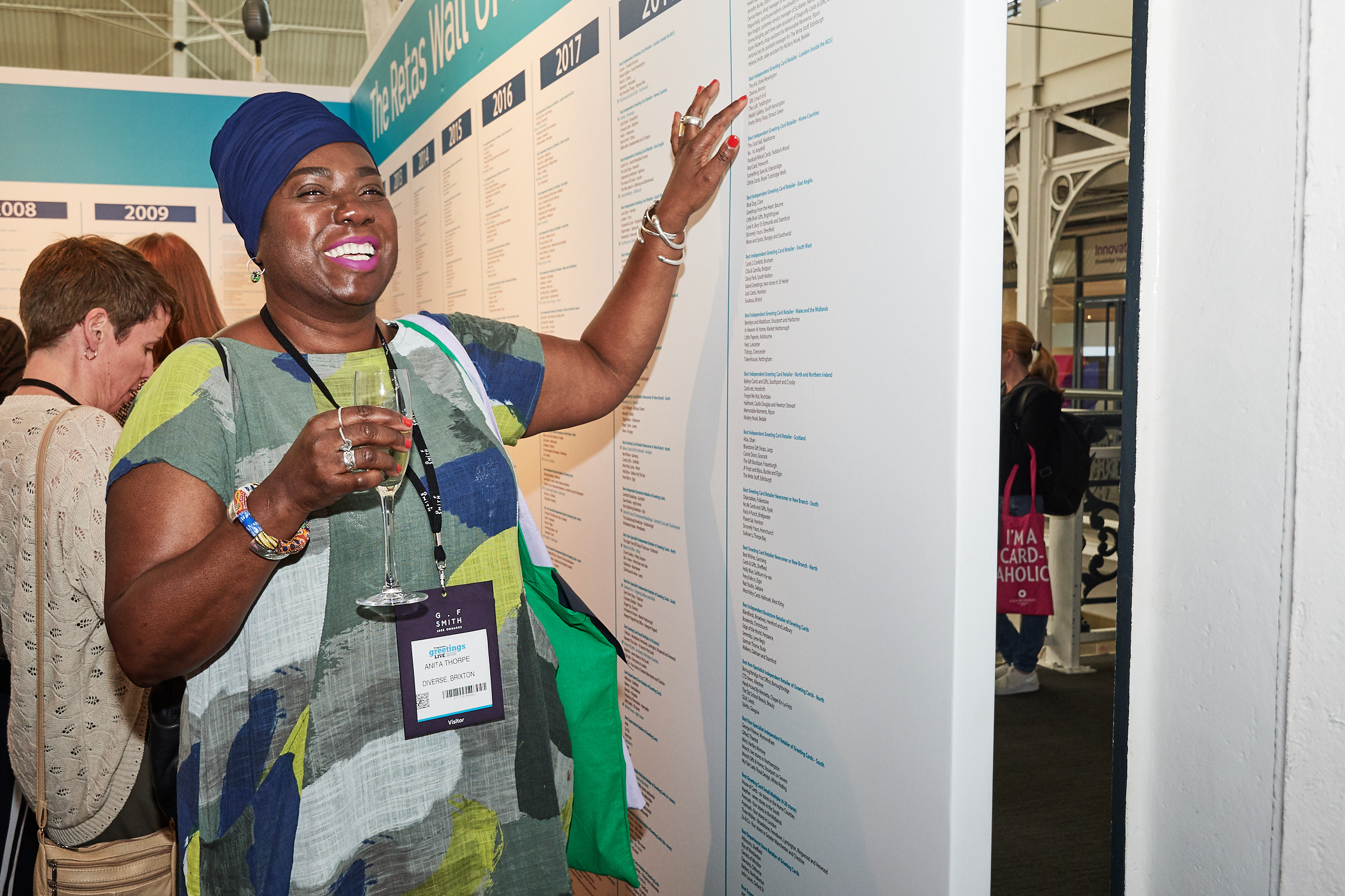 Above: Anita Thorpe, owner of Diverse delighted to see her shop's name on the Wall of Fame at the show.