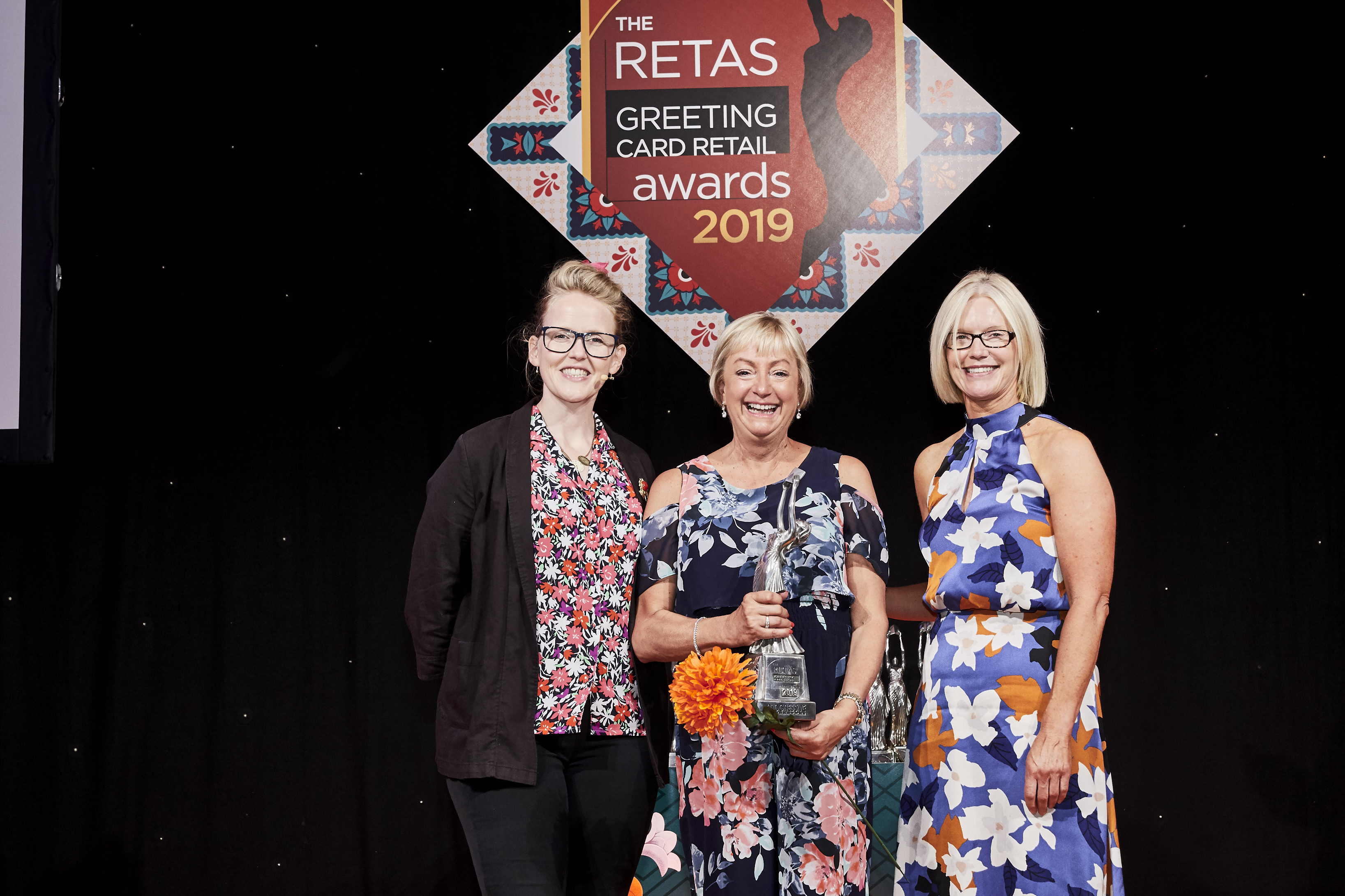 Above: Island Greetings' owner Alison Baker, accepts her Retas award from Alison Butterworth, managing director of Nigel Quiney, which together with Glick sponsored this award category.