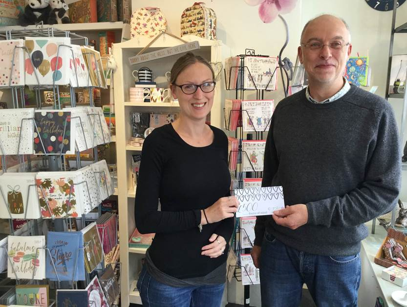 Above: Frame of Mind's owner Richard Mitchell with Charlotte Evans, the customer who won a £500 voucher to spend in the shop.