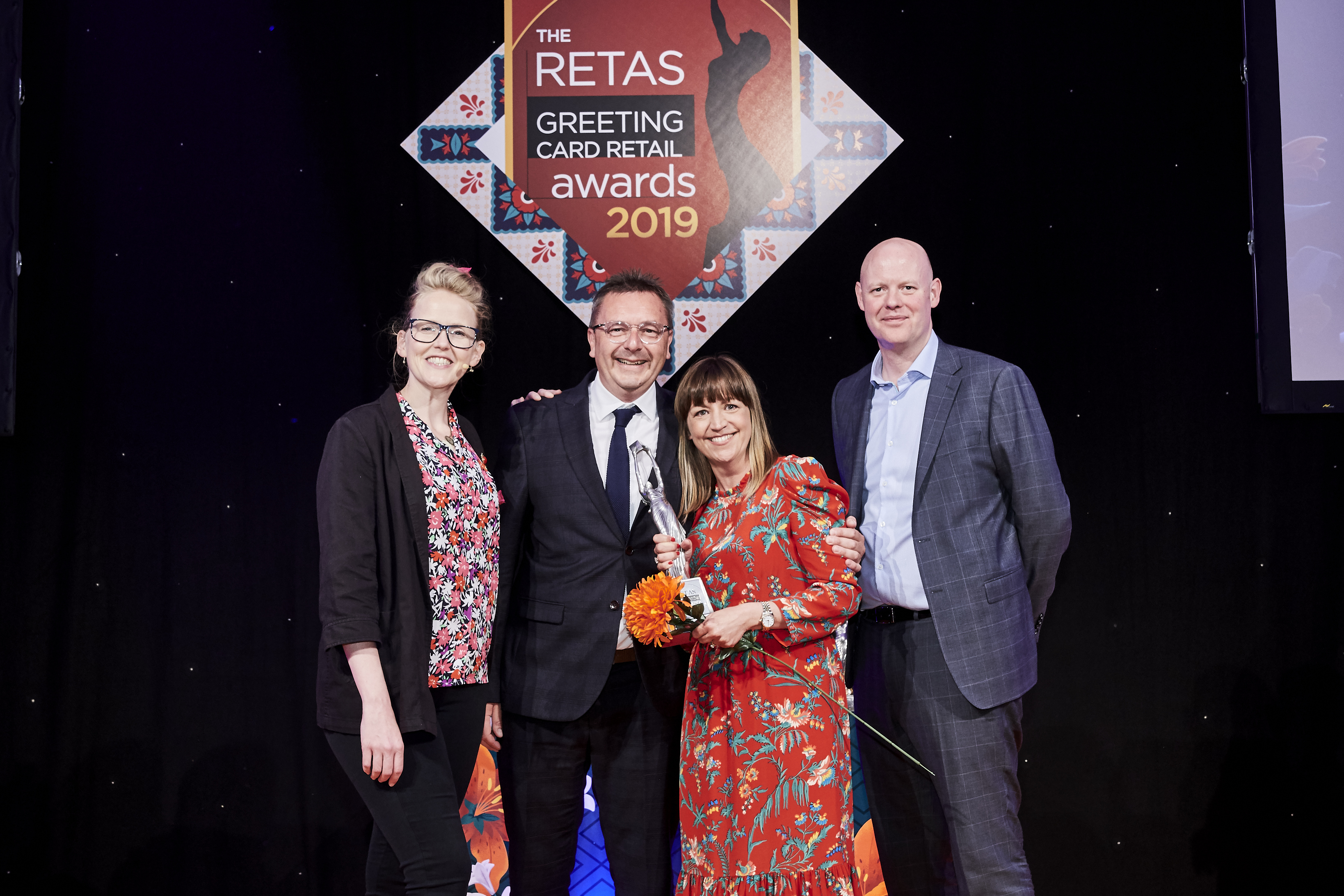 Above: Penny and (second left) Simon Bailey, co-owners of Bailey's Cards and Gifts, Southport and Crosby, were delighted to accept their Retas award from Darren Cave, commercial director of category sponsor, UK Greetings.