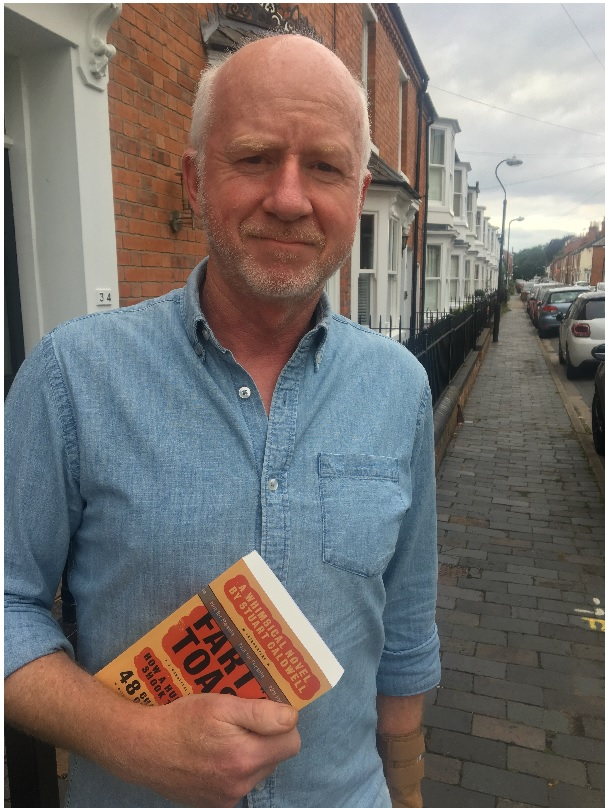 Above: Splimple founder and owner Stuart Caldwell with a copy of his new book, Fart and Toast.