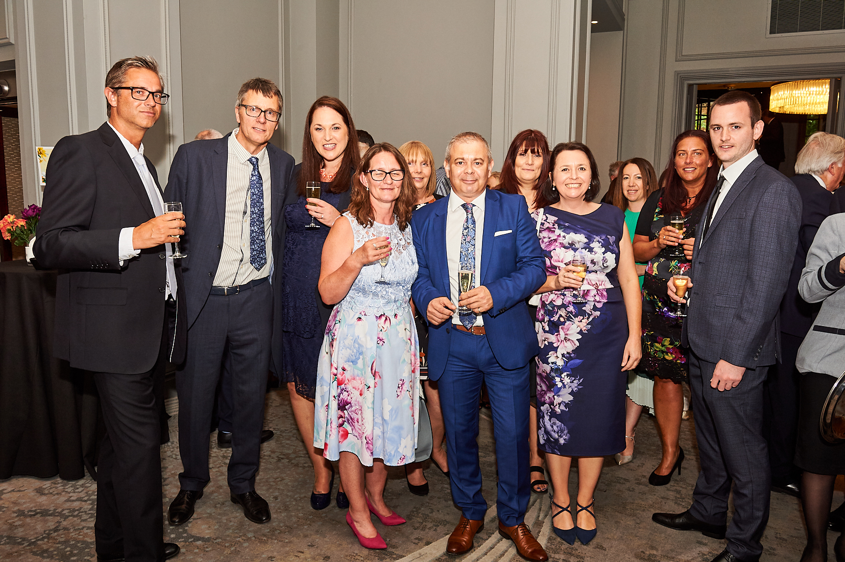 Above: House of Cards' Miles Robinson (centre) and Nigel Williamson (second left) with chums and colleagues The Retas in July.