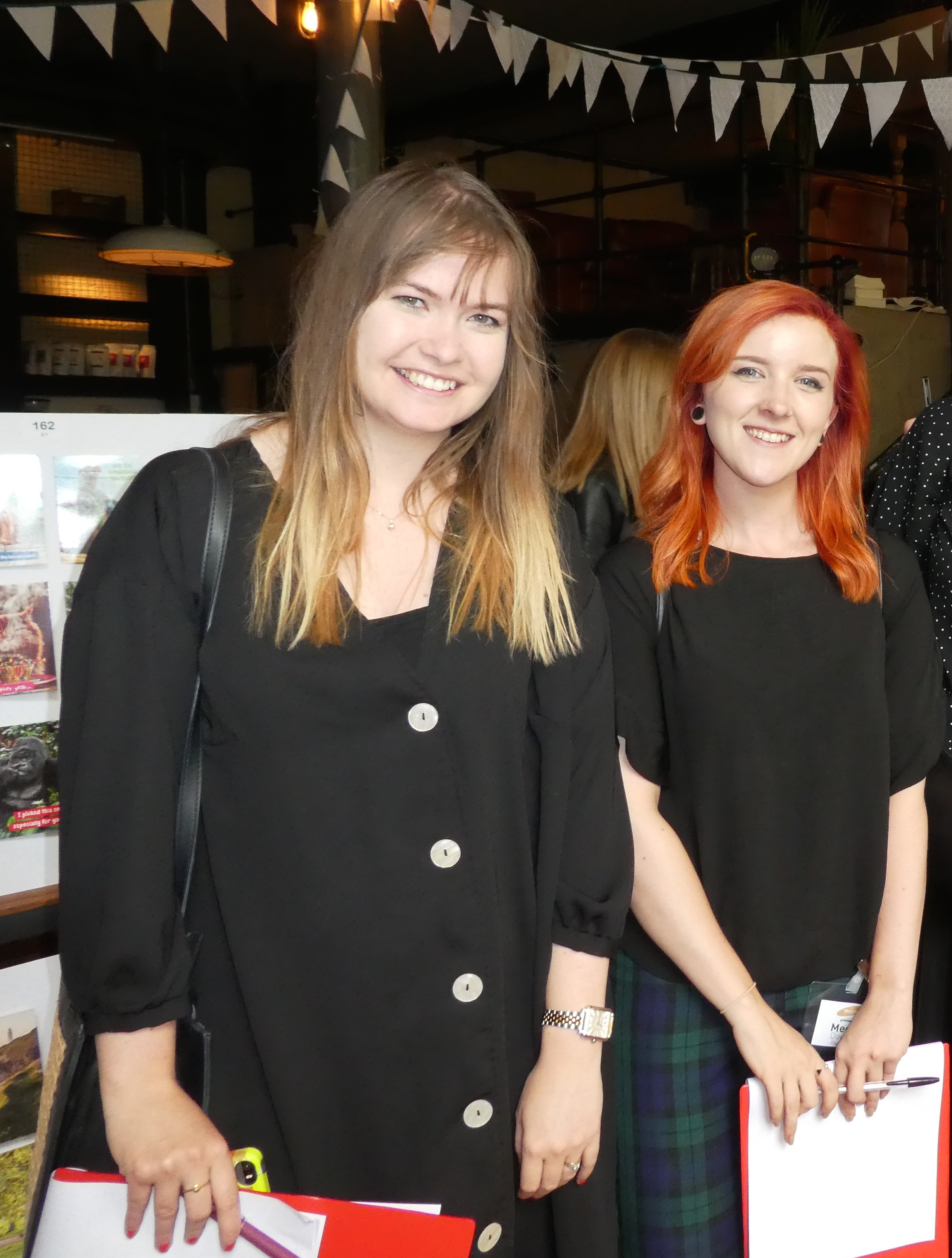 Above: Daisy Enticott (left) with colleague Megan Douglas at the recent Henries judging.