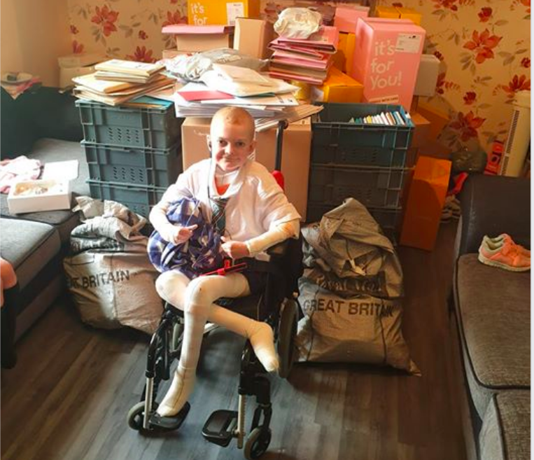 Above: Wheelchair-bound Rhys with just a small proportion of the cards he has received.