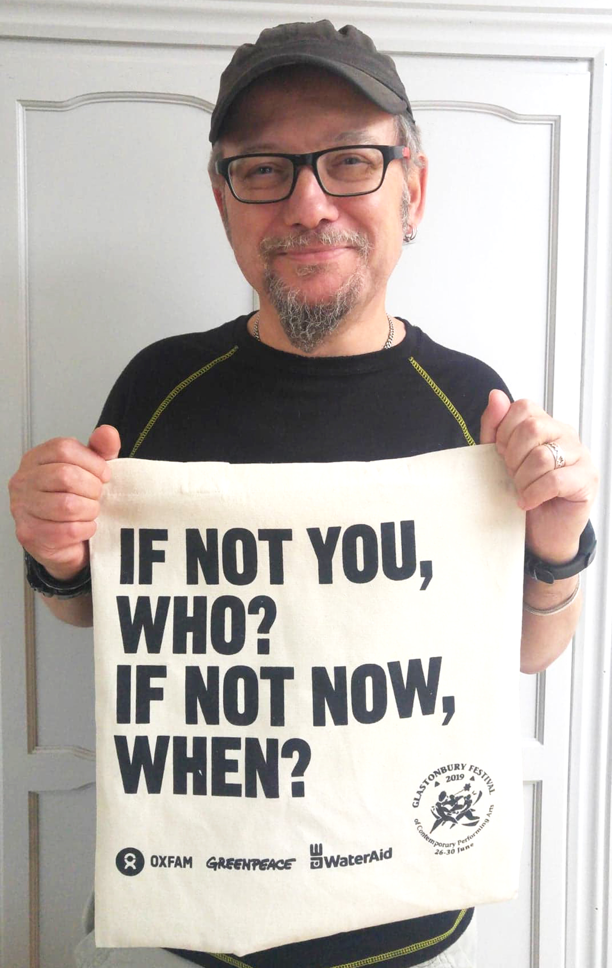 Above: John Higgins, co-founder of Go La La holding a tote bag from this year's Glastonbury Festival (which banned the sale of single use plastics). The statement 'what are we all waiting for?!!' resonated with John and Laura.