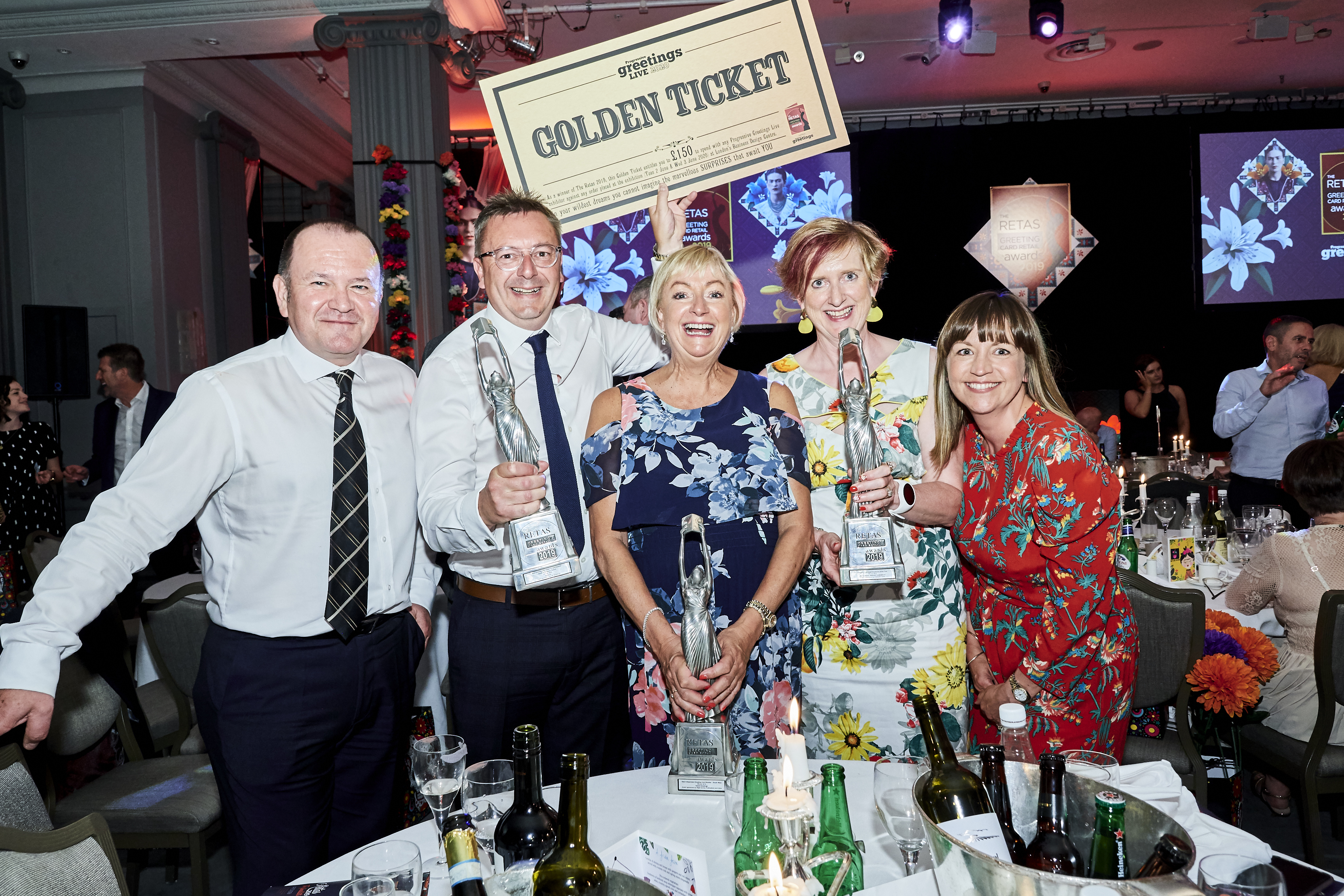 Above: A jubilant trio of Retas winners. (Left-right) Hallmark's Graeme Francis with Simon Bailey (Bailey's), Alison Baker (Island Greetings), Lynda Bygrave (Celebrations) and Penny Bailey (Bailey's).