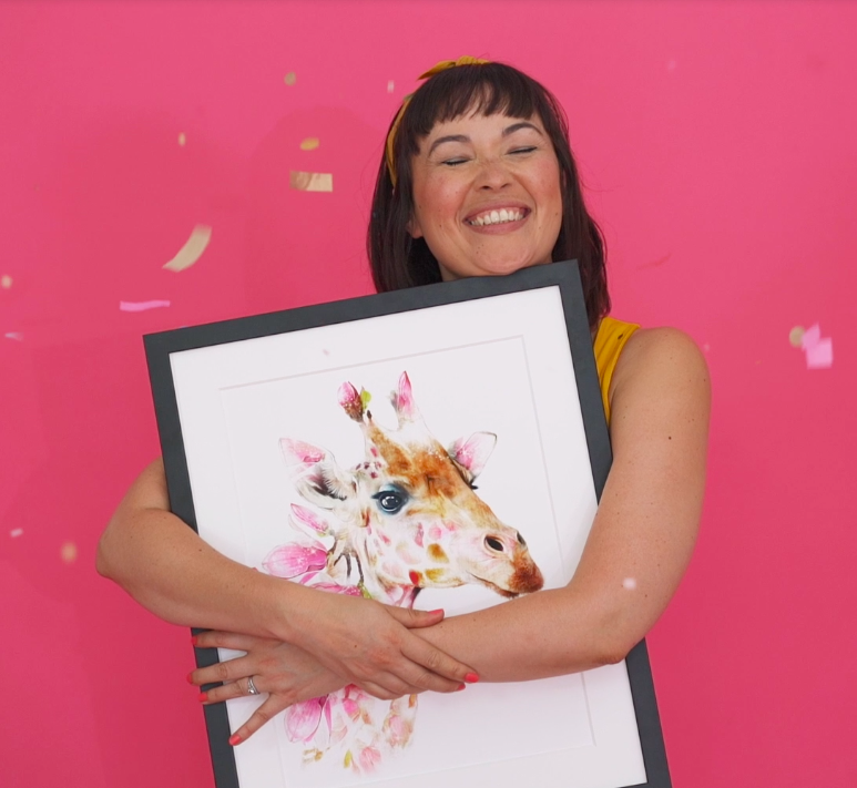 Above: Amanda Fountain, creator and co-founder of Lola Design with one of the Wildlife Botanicals designs.