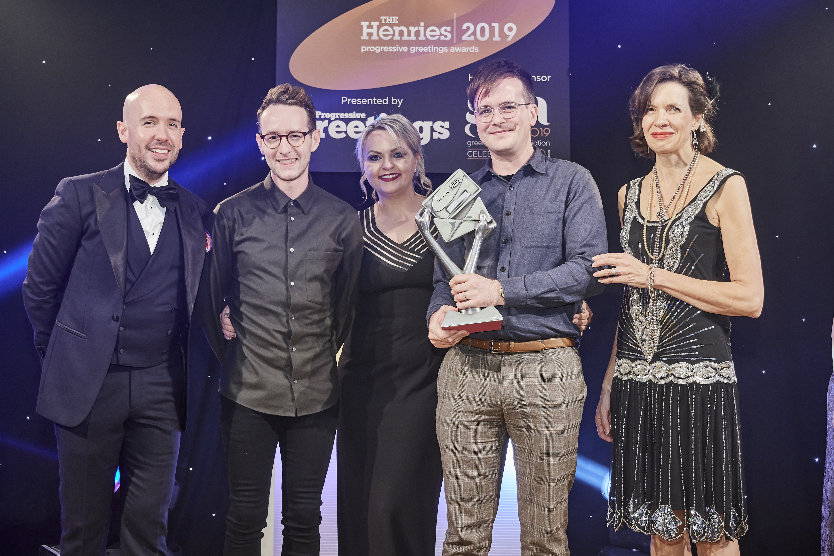 Above: Ohh Deer's co-owners, Mark Callaby (second right) and Jamie Mitchell went on stage with Emma-Louise Allen, key account manager of Windles to receive the trophy from Amanda Fergusson, ceo of the GCA, sponsor of this award.