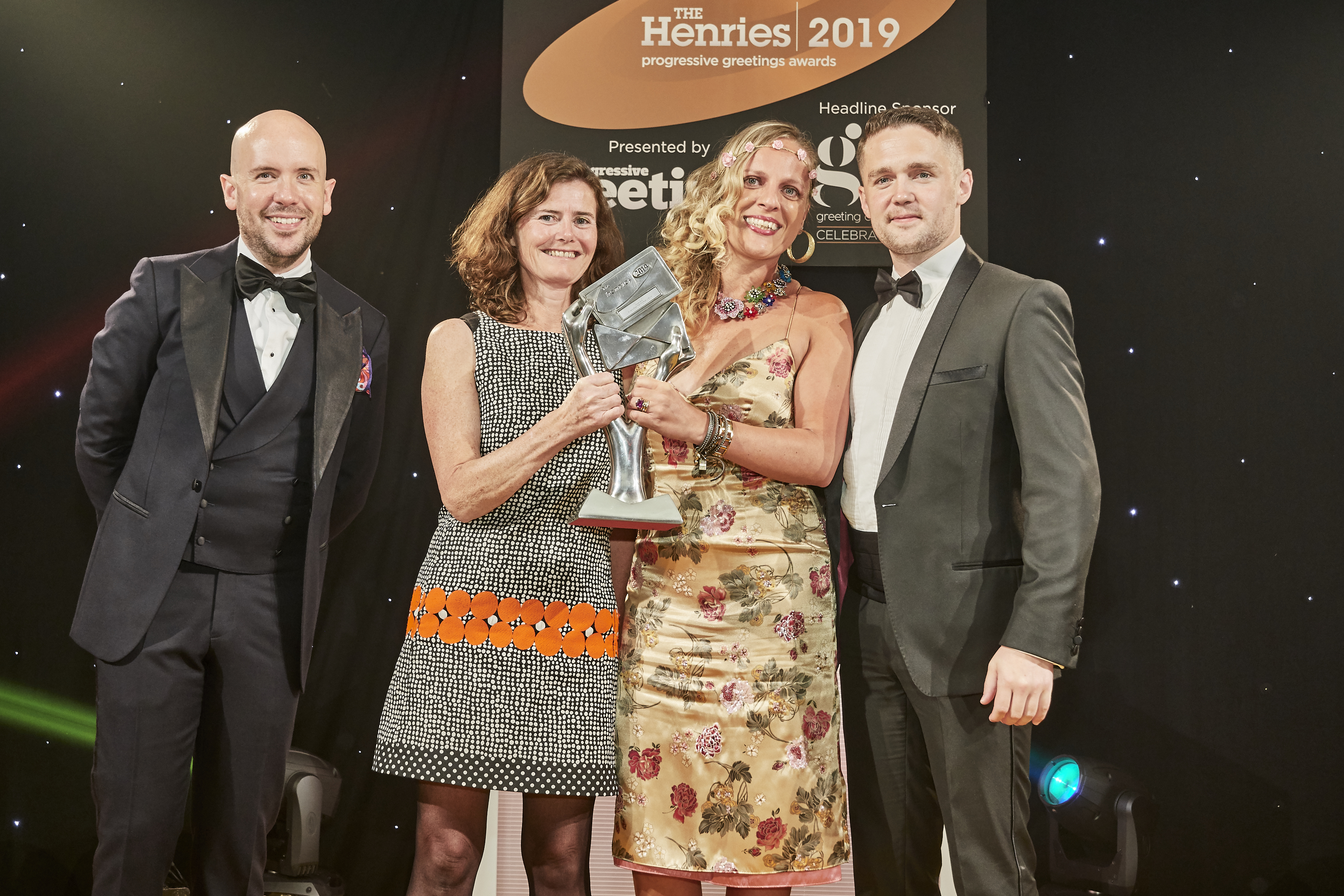 Above: Roger la Borde's production director Julie Hadingham (second left) and operations director Michaela Vrabelova, were delighted to be presented with the trophy by Marcus Fenner, sales director of Fenner Paper, which sponsored this award.