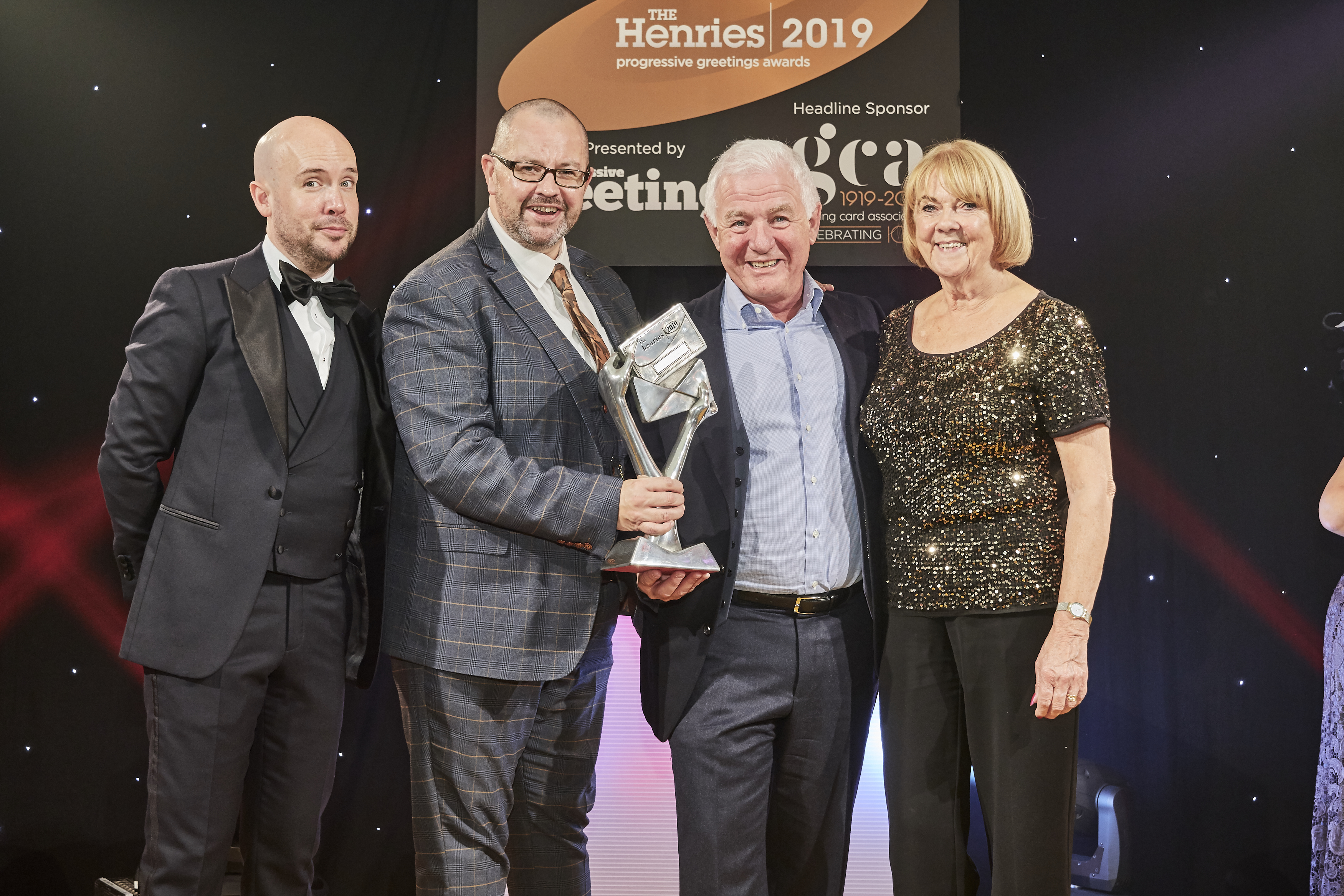 Above: Pete Rawlingson (second left) and Clive Rubin, co-owners of Out of the Blue Studios, were presented with their Henries' trophy by Lynda Raymond, director of LB Warehousing, sponsor of this award.