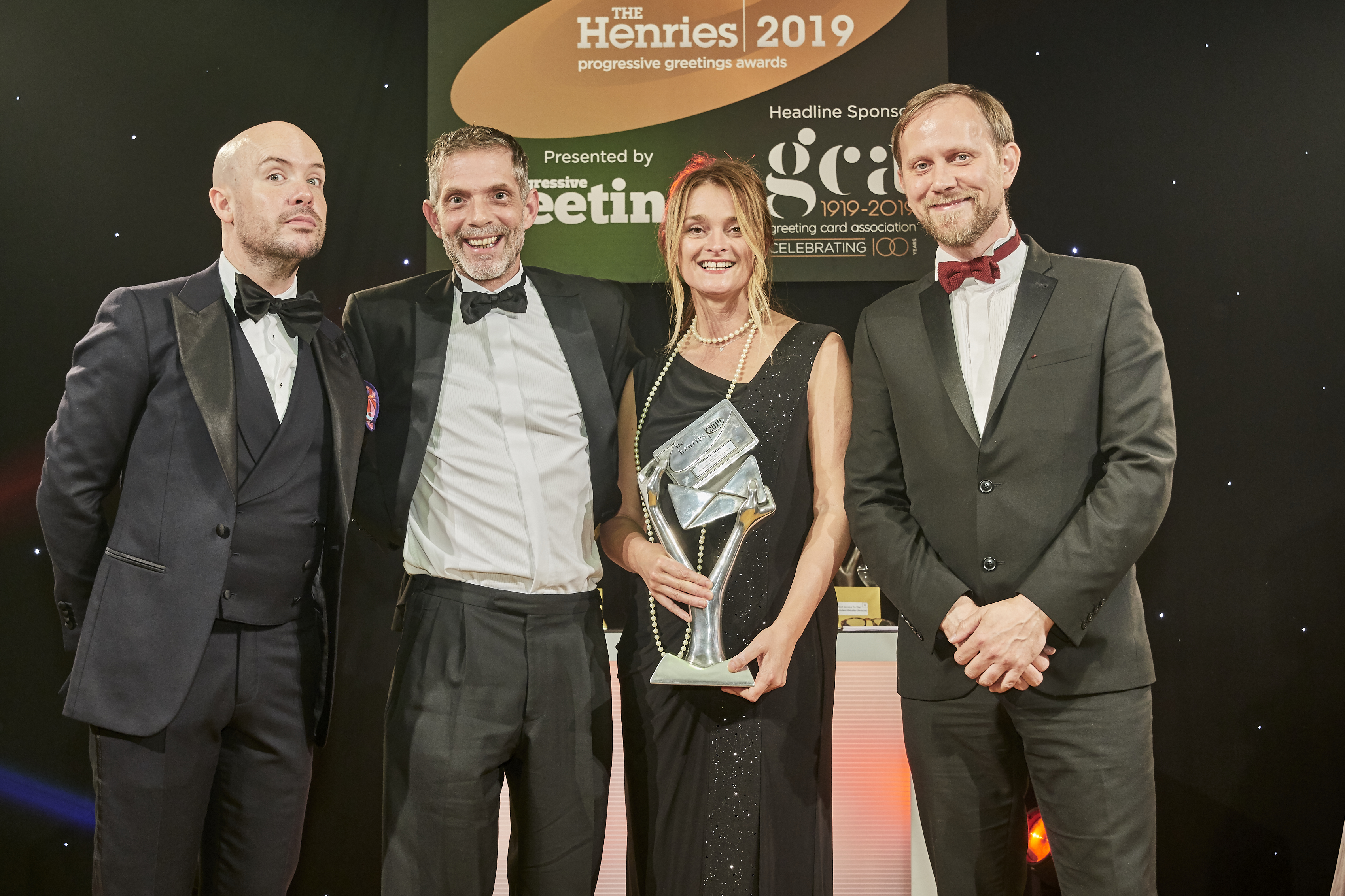Above: Steve (second left) and Wendy Jones-Blackett, directors of Wendy Jones-Blackett, collected the award from Mark Jessett, paper consultant for GF Smith's, sponsor of this category.