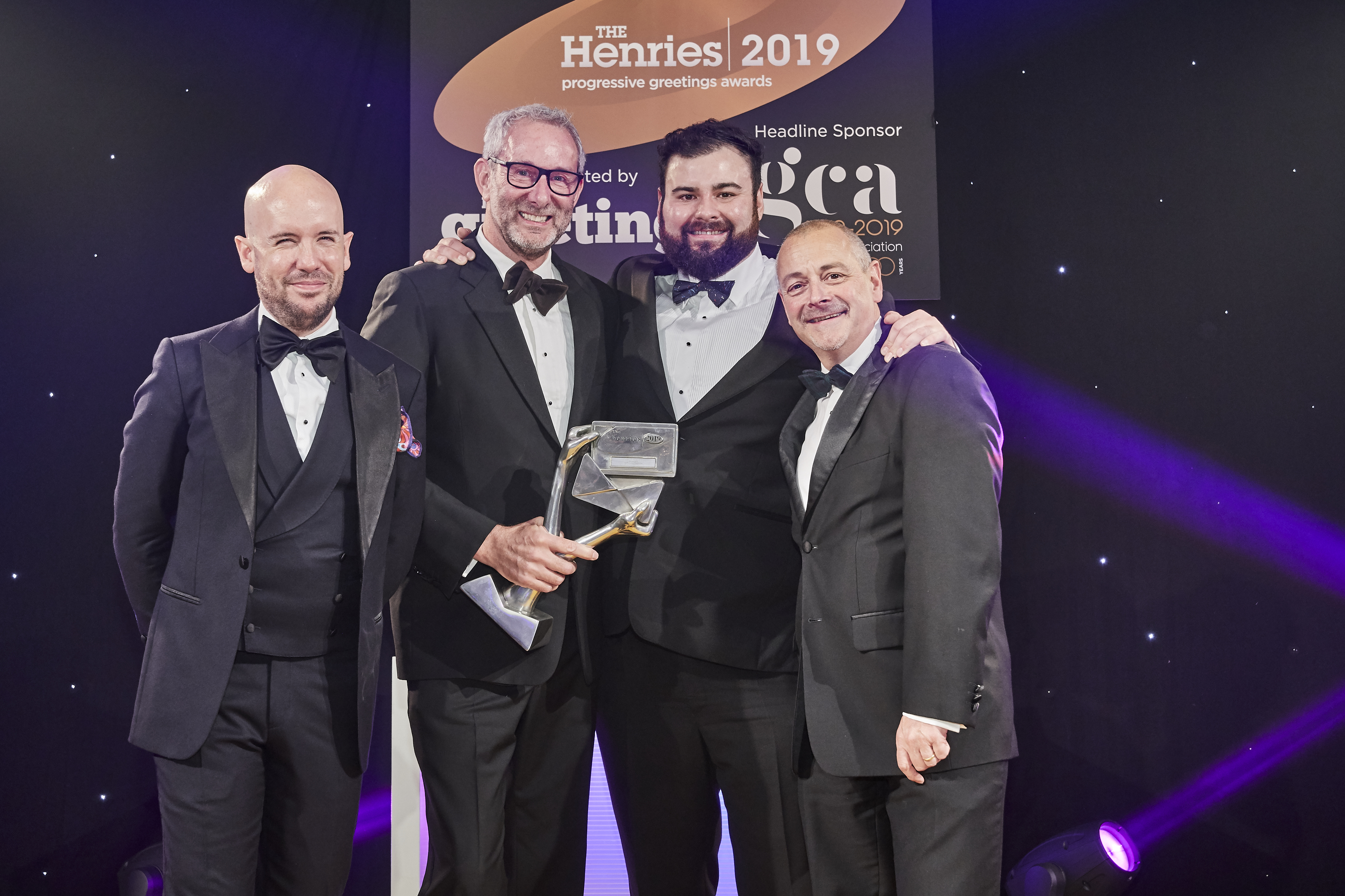 Above: The Art File's managing director, Ged Mace (second left) and sales & marketing manager James Mace (second right) were delighted to be presented with the trophy by Jeremy Bacon, ceo of category sponsor, The Sherwood Group.