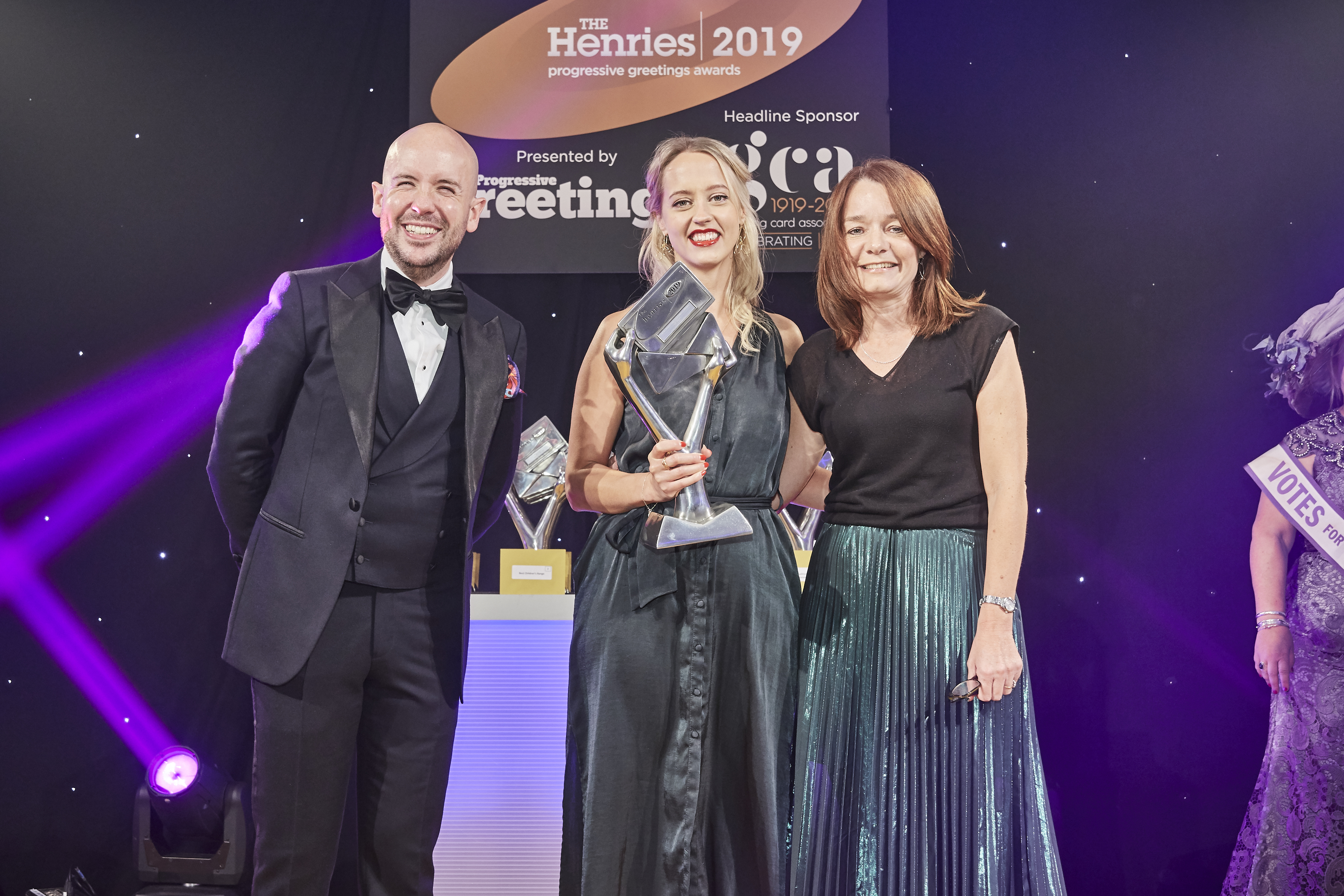 Above: Amy Eastland, senior designer of Woodmansterne and The Proper Mail Company (centre) was delighted to accept the trophy from Frances Burkle, product director for Paperchase, sponsor of this category.