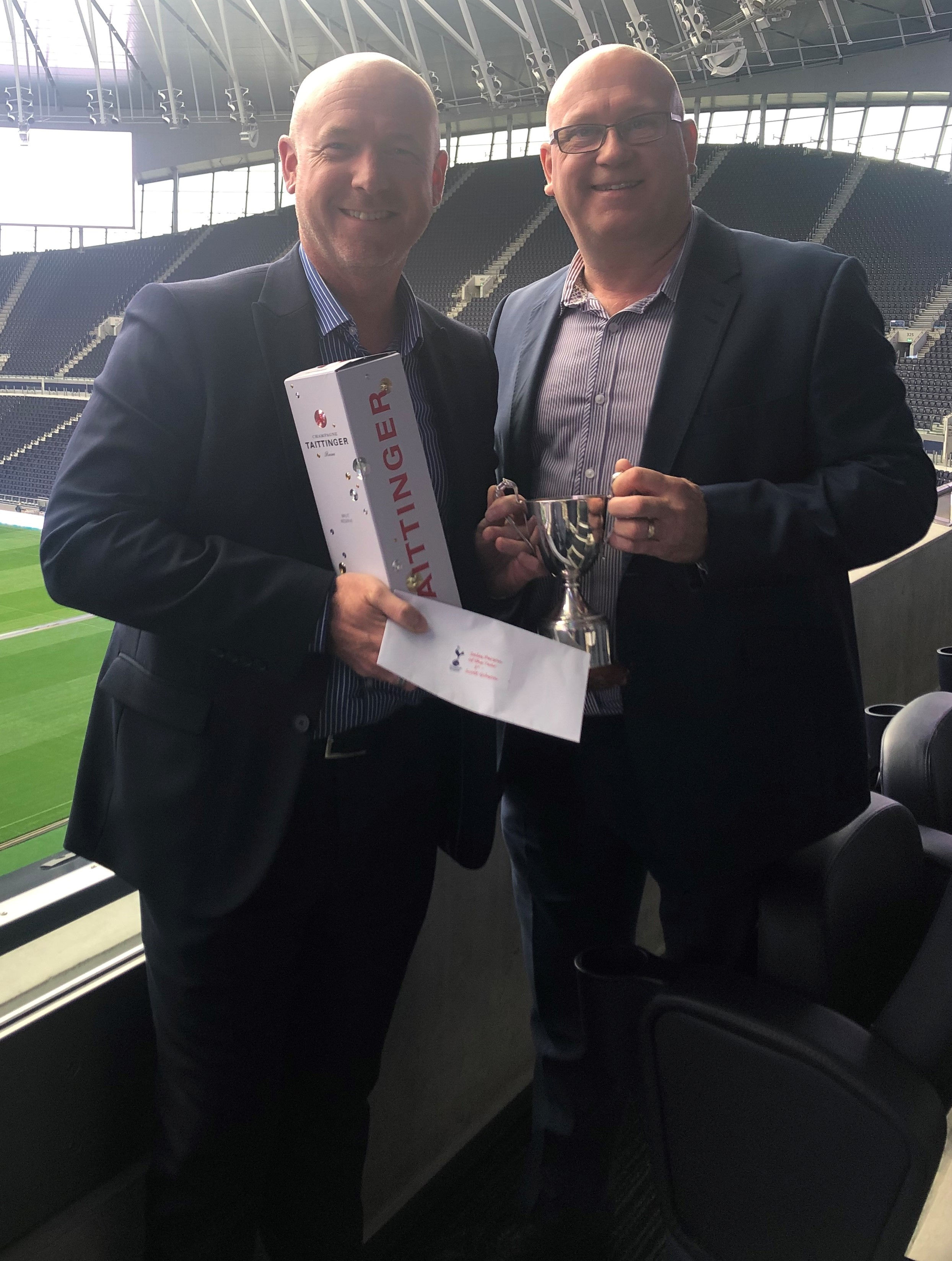 Above: Scott Gibson (left) received the Sales Person of the Year Award from Words 'n' Wishes joint md Carl Salt.