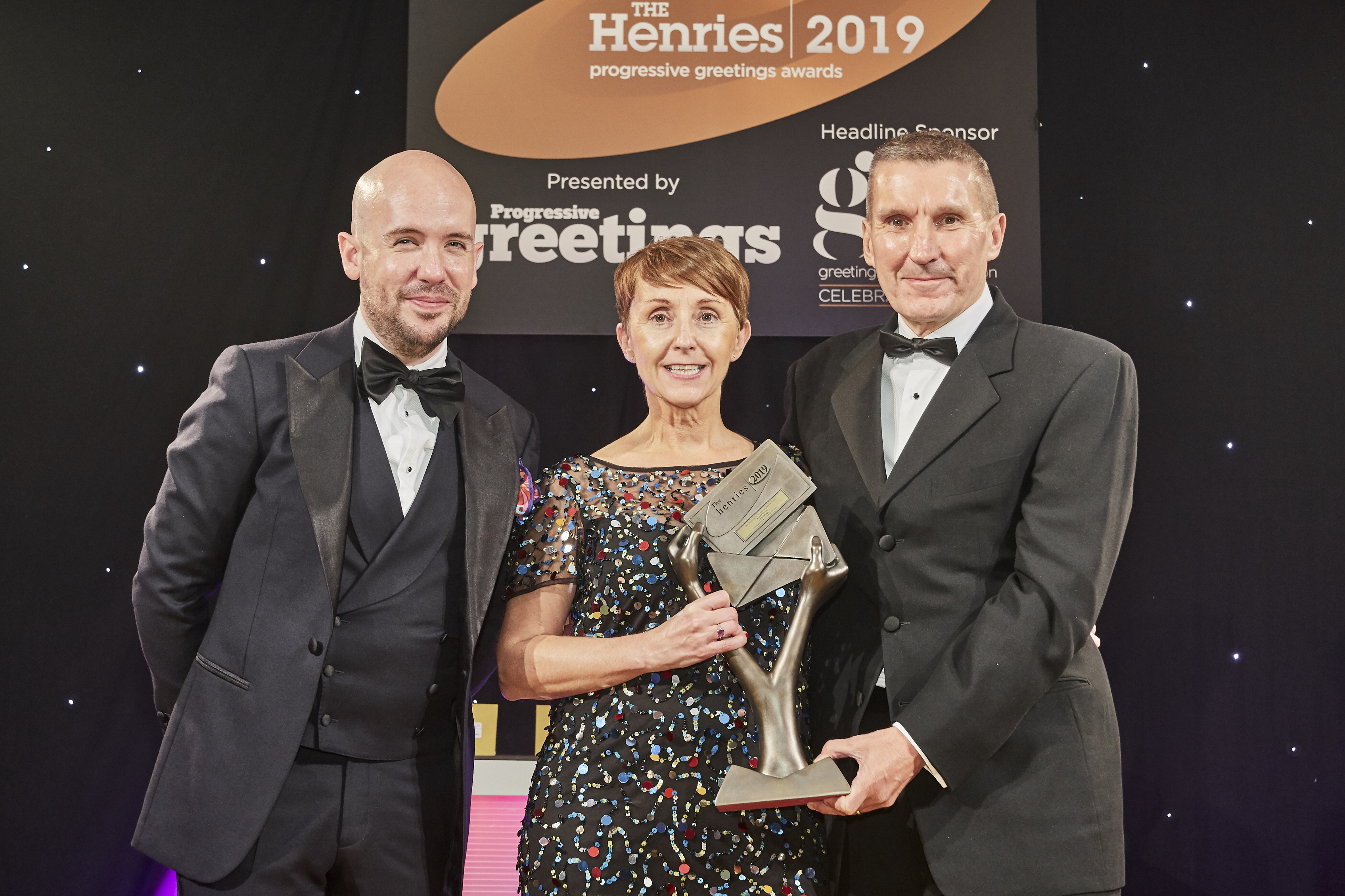 Above: UK Greetings' customer and channel director Ceri Stirland was presented with the Bronze trophy by Richard Campbell, managing director of Herbert Walkers, sponsor of the Best Service trio of awards.