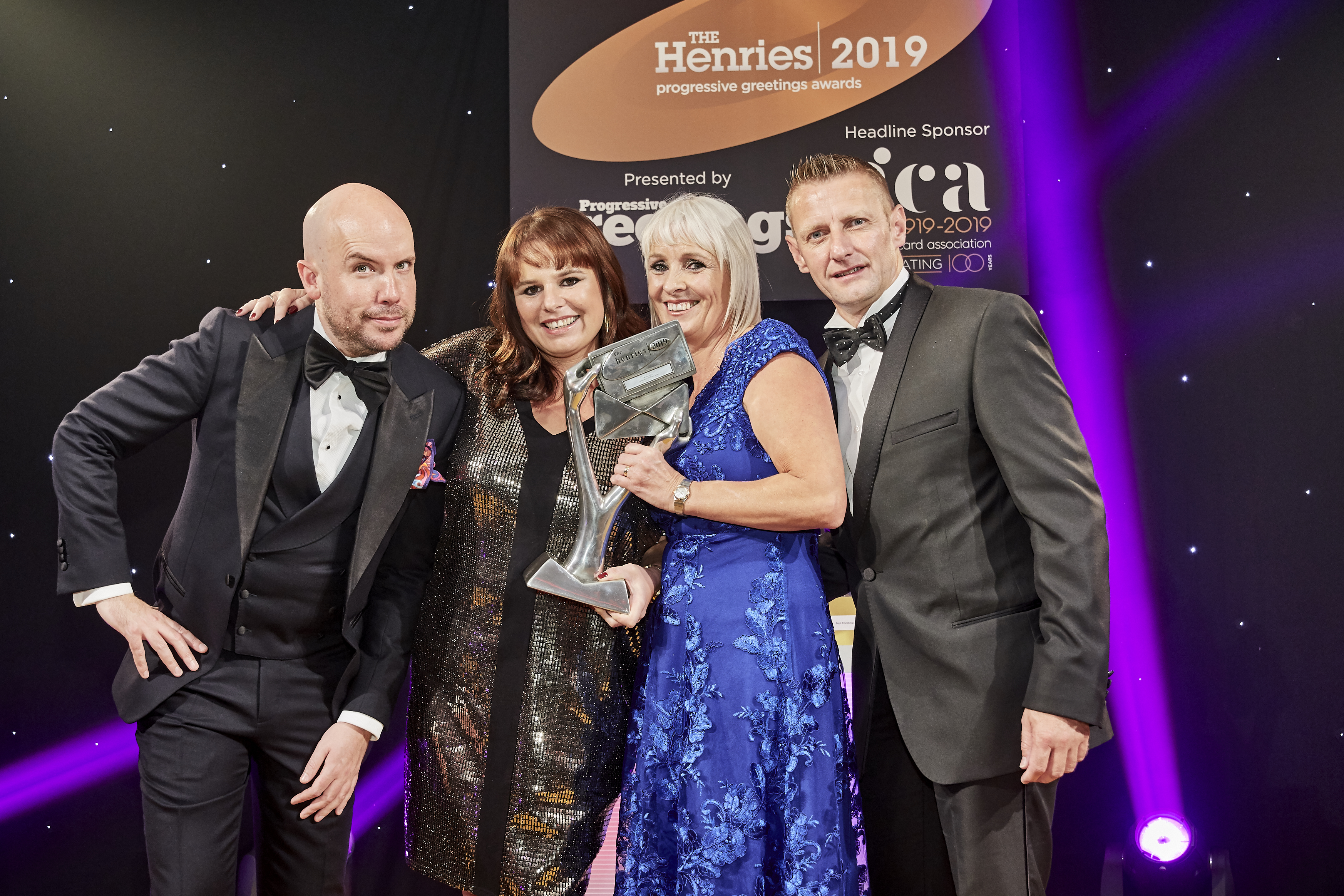Above: Karen Wilson (second right) and Claire Williams, co-owners of Paper Salad, enjoying the moment, having been presented with the trophy by Tony Loriman, managing director for Loxleys, the category sponsor.