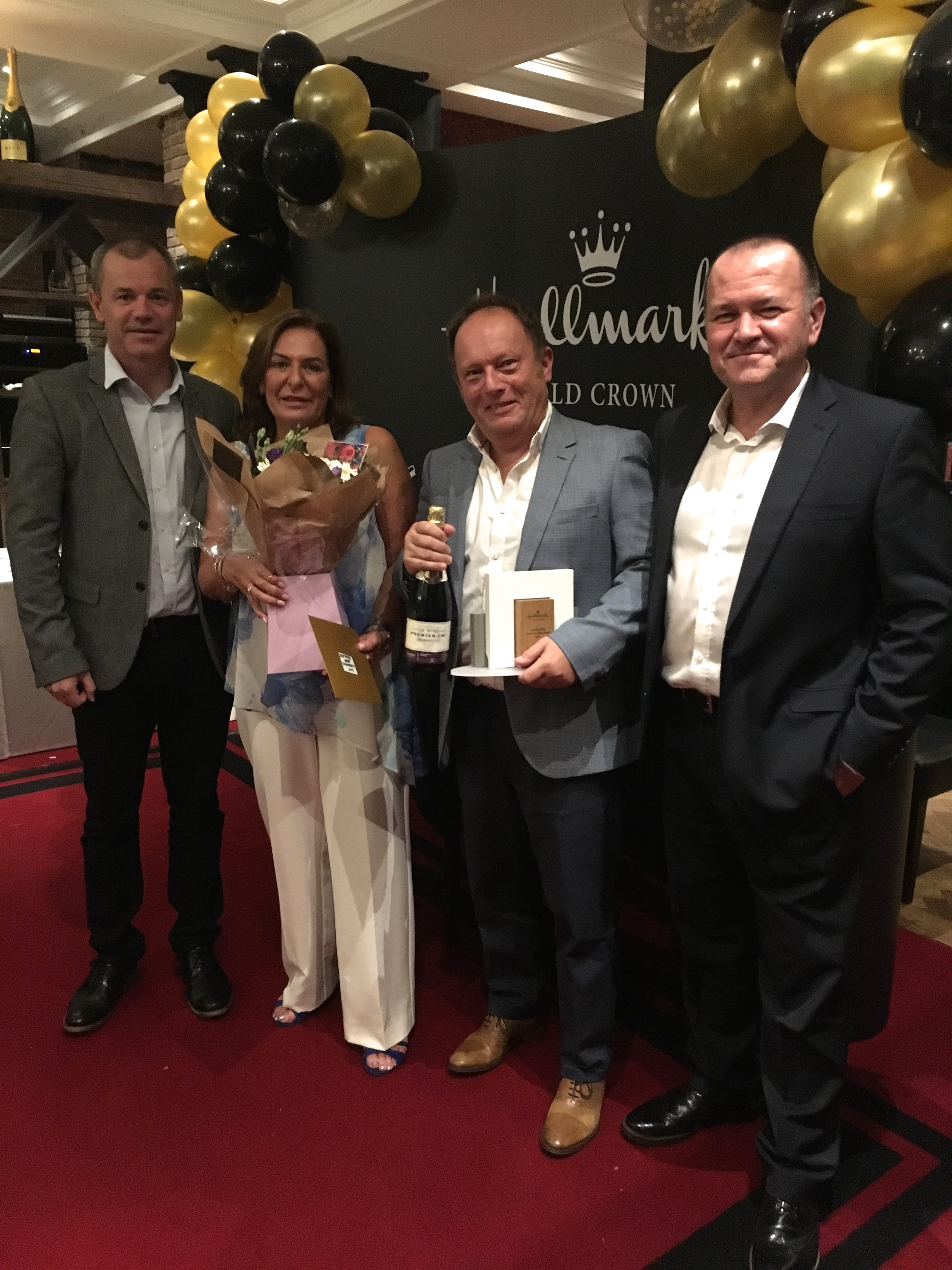 Above: QLM's (second right)Maurice Esofsky and Debbie Zoltie were presented with their Outstanding Store Development Award by Gold Crown's (right)Graeme Francis and Hallmark'sCiaran Leonard.