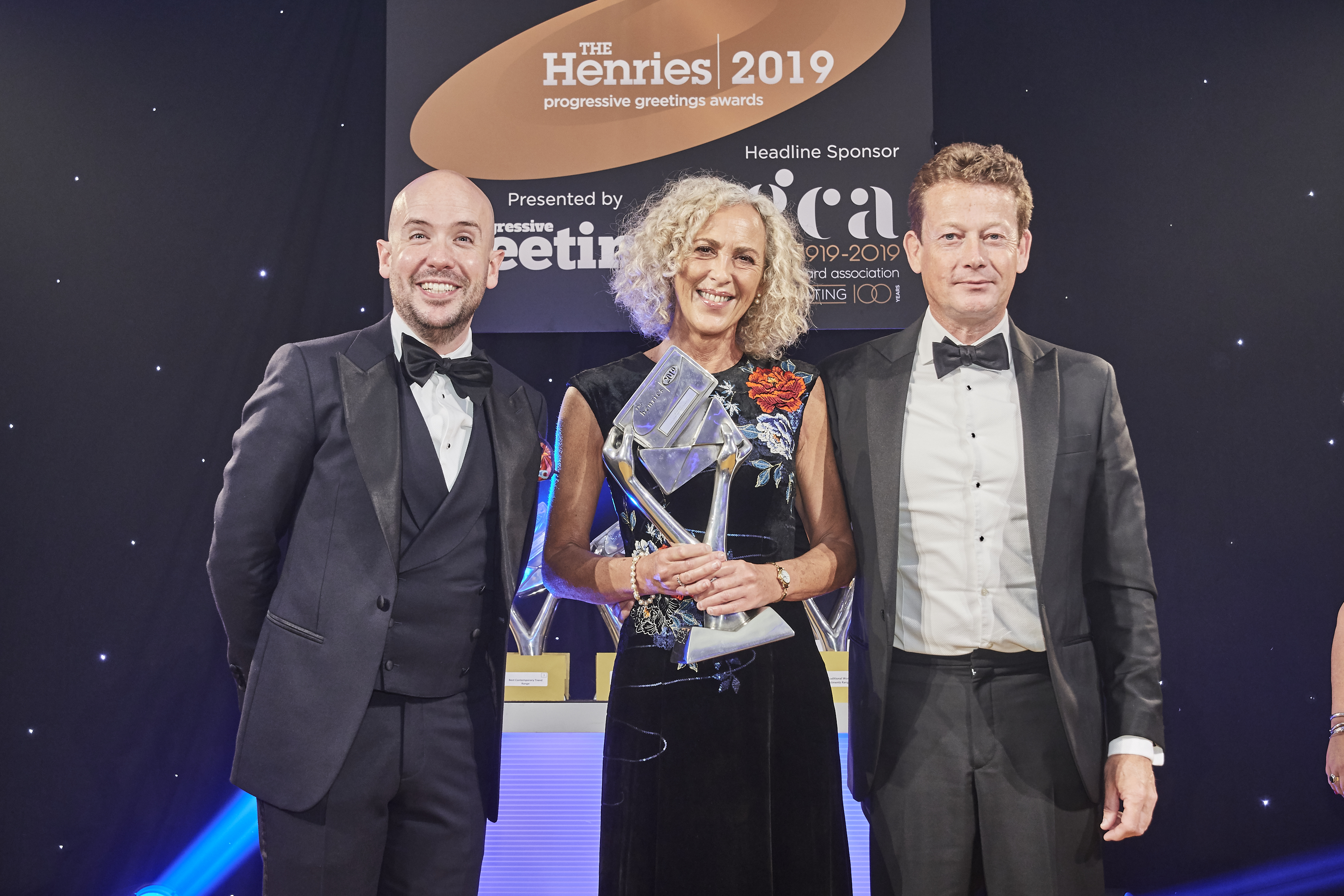 Above: Karen Mace, director of The Art File, proudly accepted The Henries' trophy from Nick Henry, managing director of Gould Paper's, sponsor of the category.