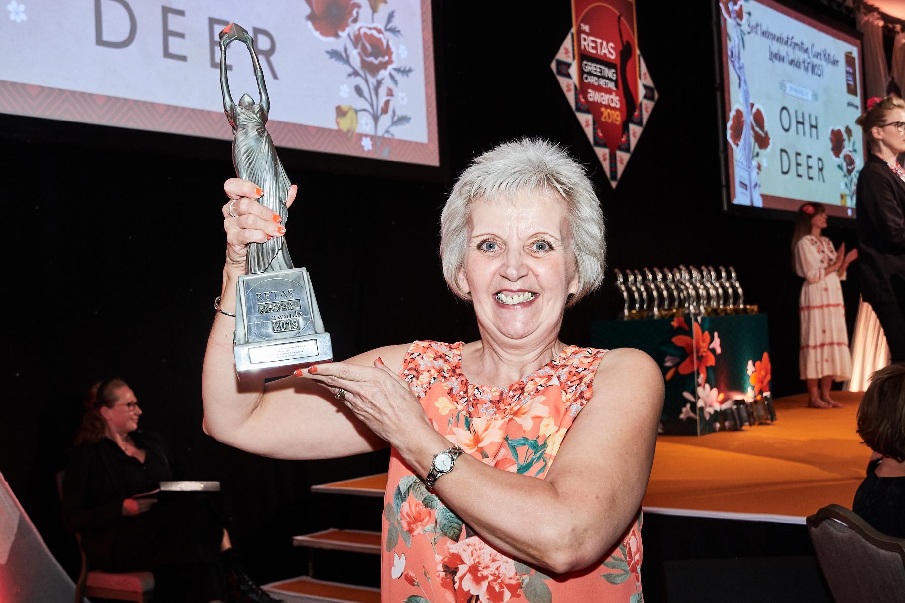 Above: Celebrations' Mandy Baker with her Retas' award trophy.