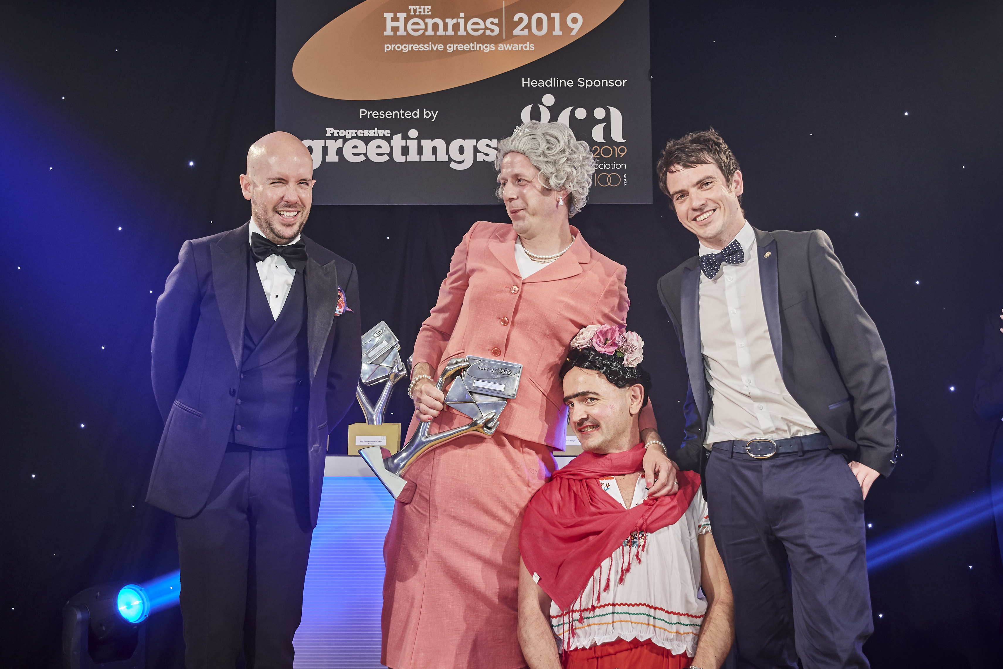 Above: As ever, (second left-right), the Brainbox Boys, Mark Williams and Ben Hickman, co-founders of Brainbox Candy came unforgettably attired! They were presented with their award by Adam Short, managing director of The Imaging Centre, sponsor of this category.