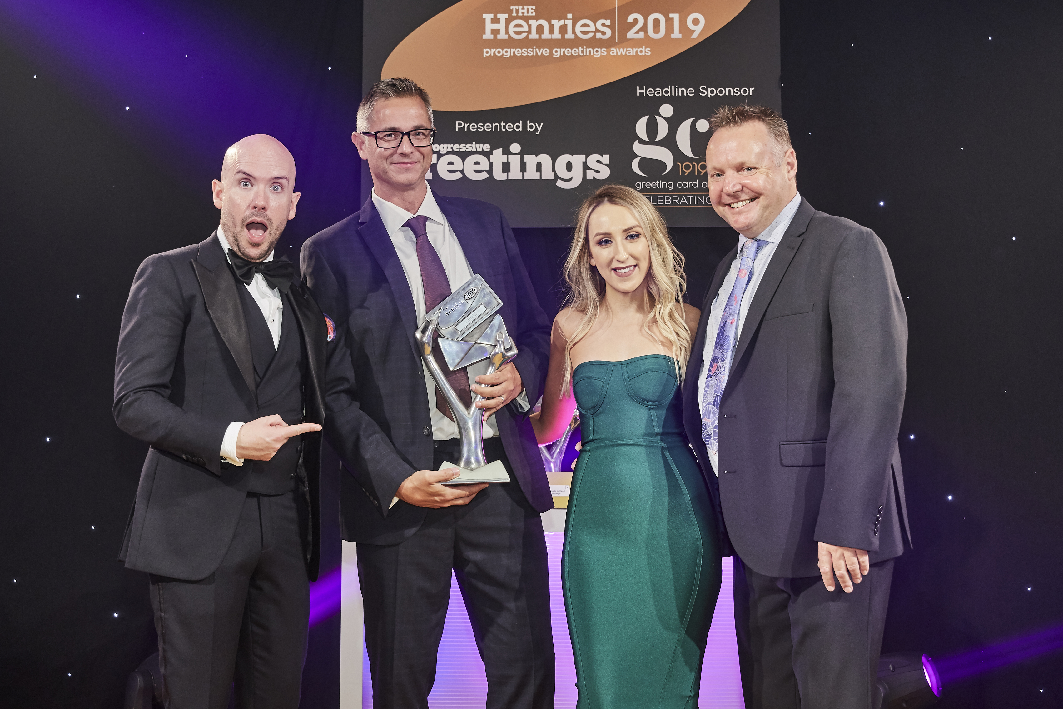 Above: Picking up their second trophy of the evening, (second left) Chris Stanley, co-owner of Redback Cards and sales and marketing manager Sean Edwards collected the trophy from Alice Buck, marketing manager for Digital Hub, sponsor of this category.