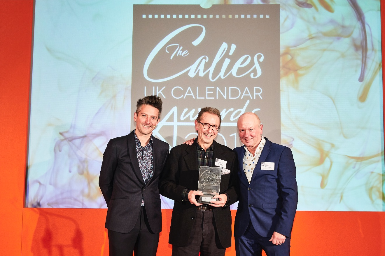 Above: Max Publishing's Warren Lomax (right) felt very honored to present the prestigious Calies' Calendar. Ambassador 2019 award to Nigel Green, owner of Eight Days A Week.