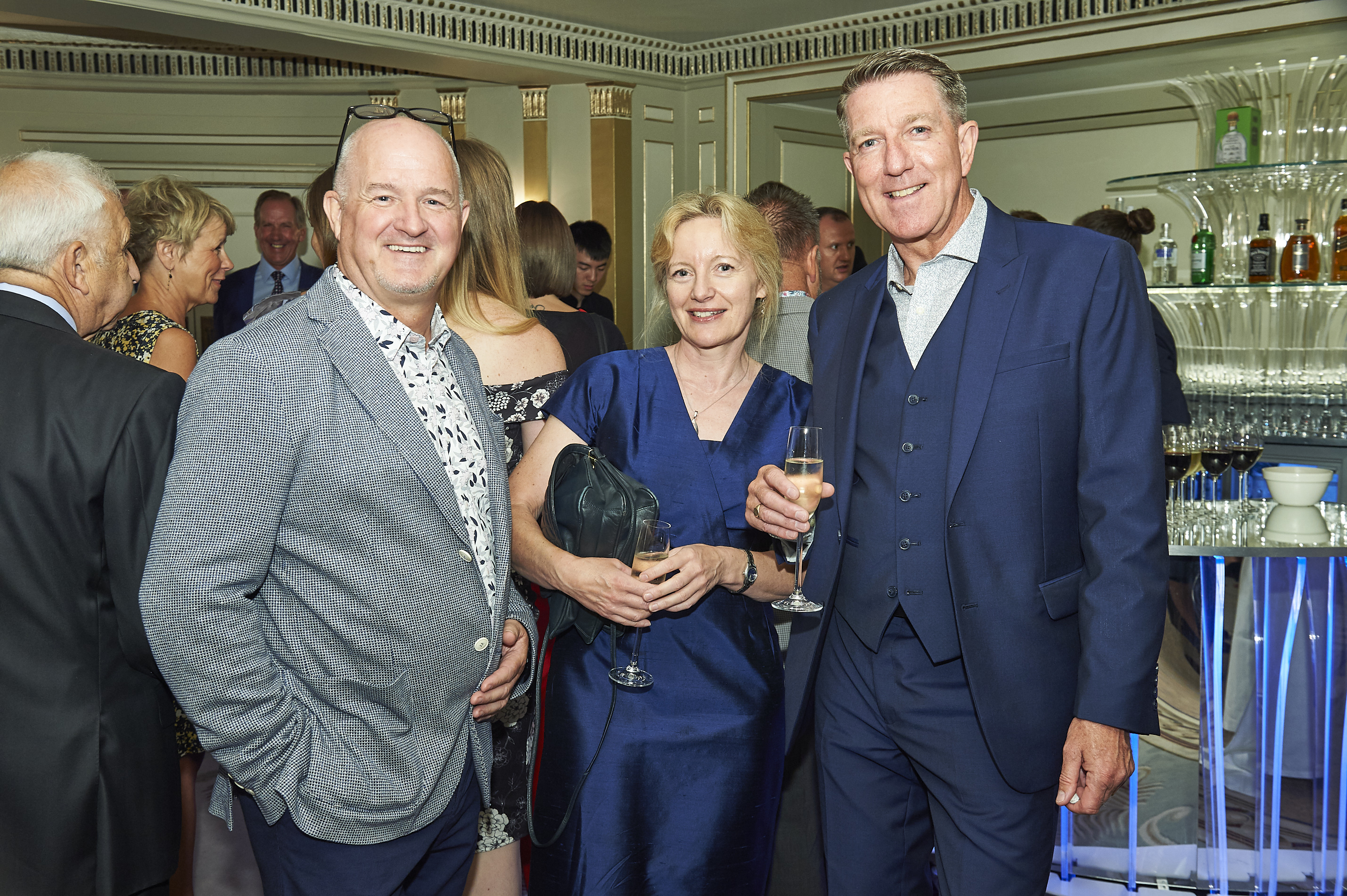 Above: Chris Houfe (left) with WHSmith's Claire Castle and Martin Nevin (formerly of Is It Art and Emotional Rescue) at a Retas event when Chris and Martin were working together at Emo.