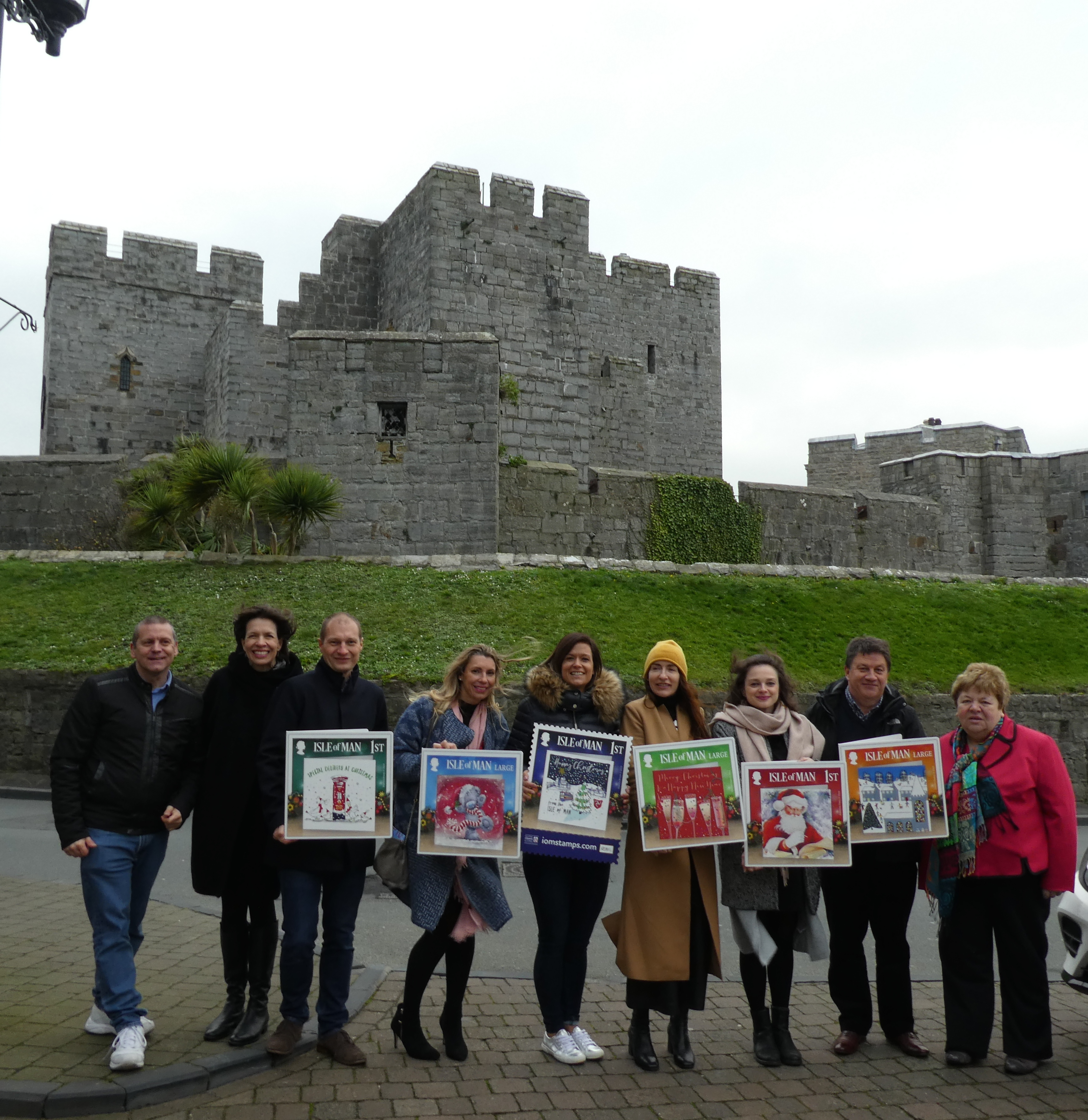 Above: (left-right) Chris Beards (Mantons), Amanda Fergusson (GCA), Stewart Brook (Marina B), Grace Elphinstone (Carte Blanche), Marina Brook (Marina B), Rachel Hare (Belly Button), Amelia Strawson (Ling), John Partridge (Peartree Heybridge) and Maxine Cannon (Isle of Man Post Office) in front of the Castletown castle.