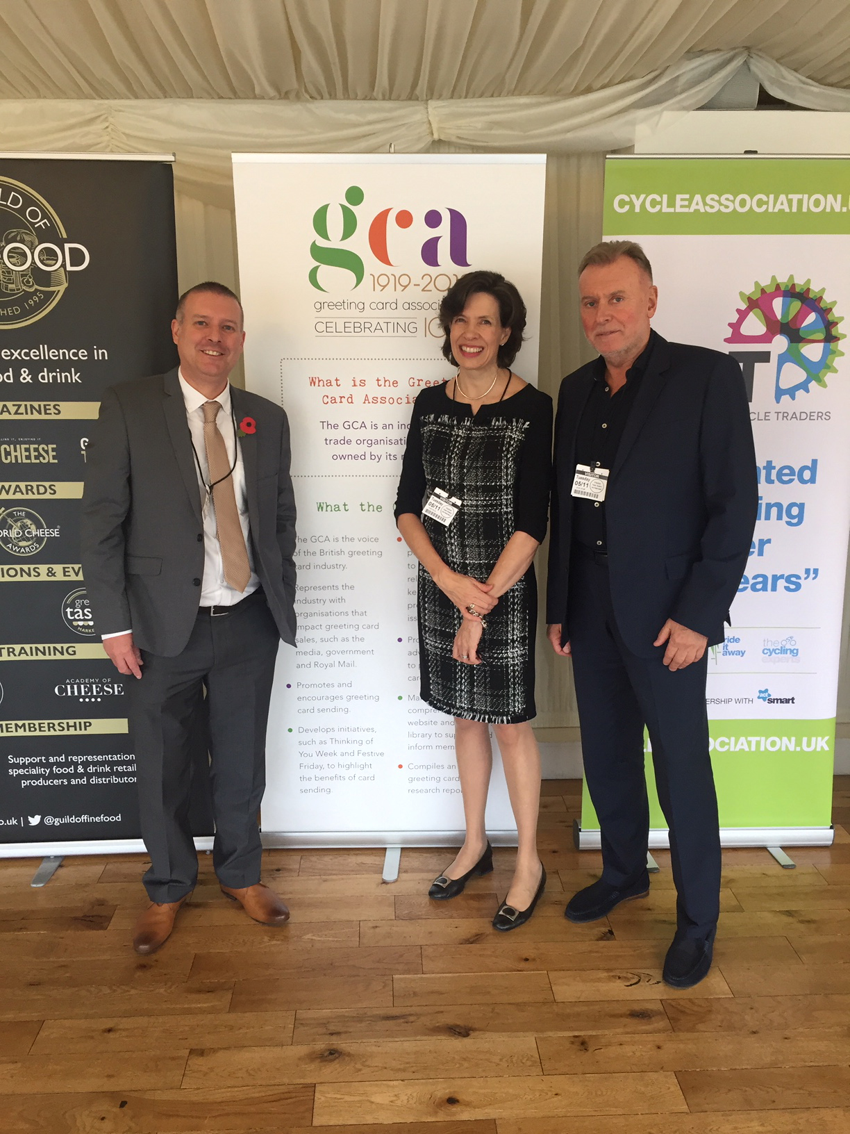 Above: IRC chairman, Mark Walmsley (right) with Amanda Fergusson, ceo of the GCA and Chris Hall, head of business development of ActSmart in Houses of Parliament in front of the GCA banner.