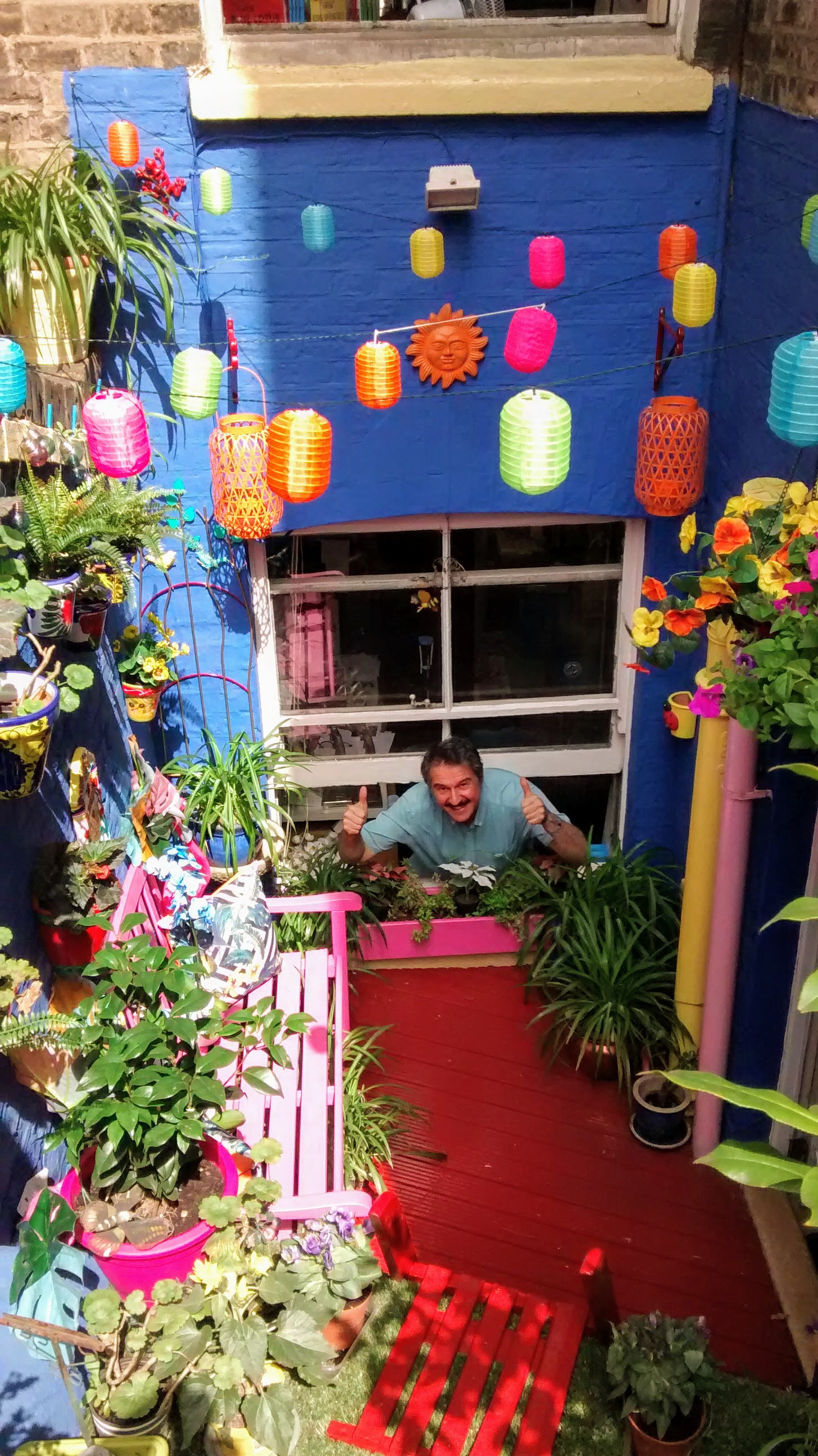 Above: Tim Reynolds, manager of the Medici Gallery, gives the thumbs up to the shop's back yard, inspired by Yves Klein's Jardin Majorelle in Marrakech.