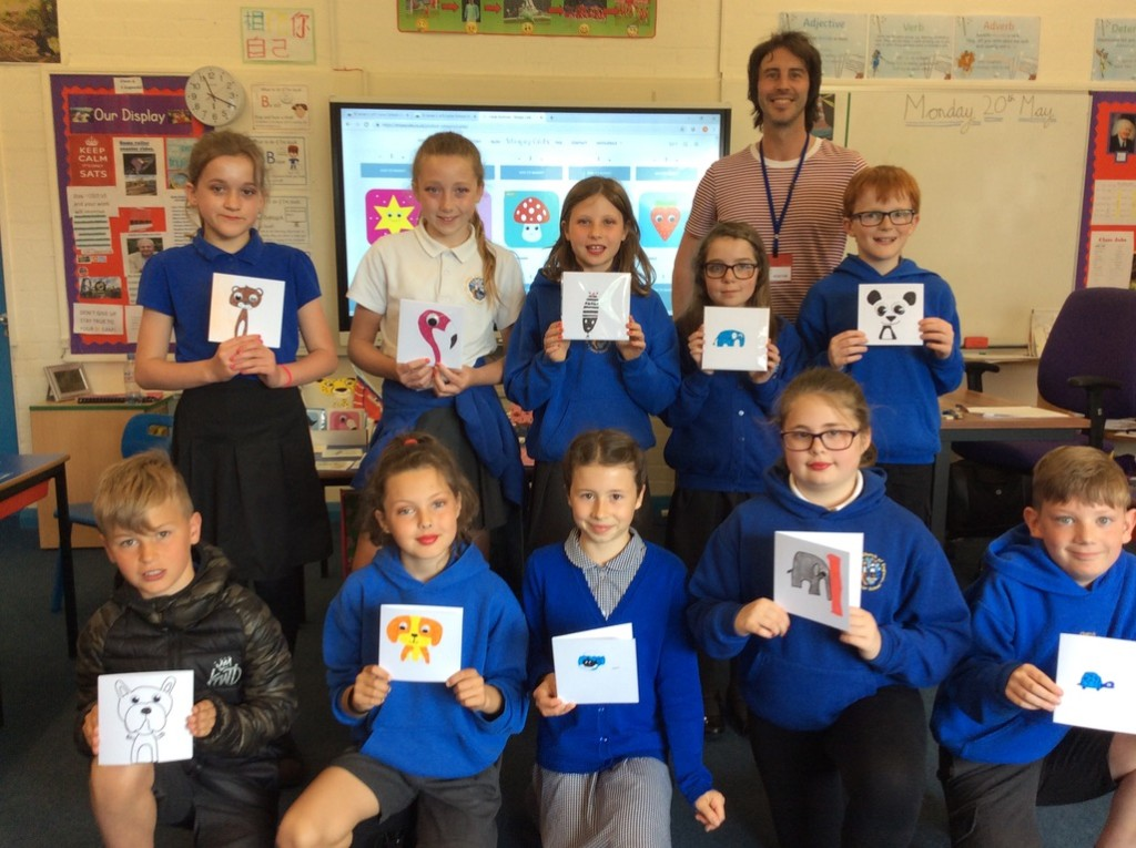 Above: Jonathan Crosby, founder of Stripey Cat Cards back in his old school with some of the current pupils and their card creations.