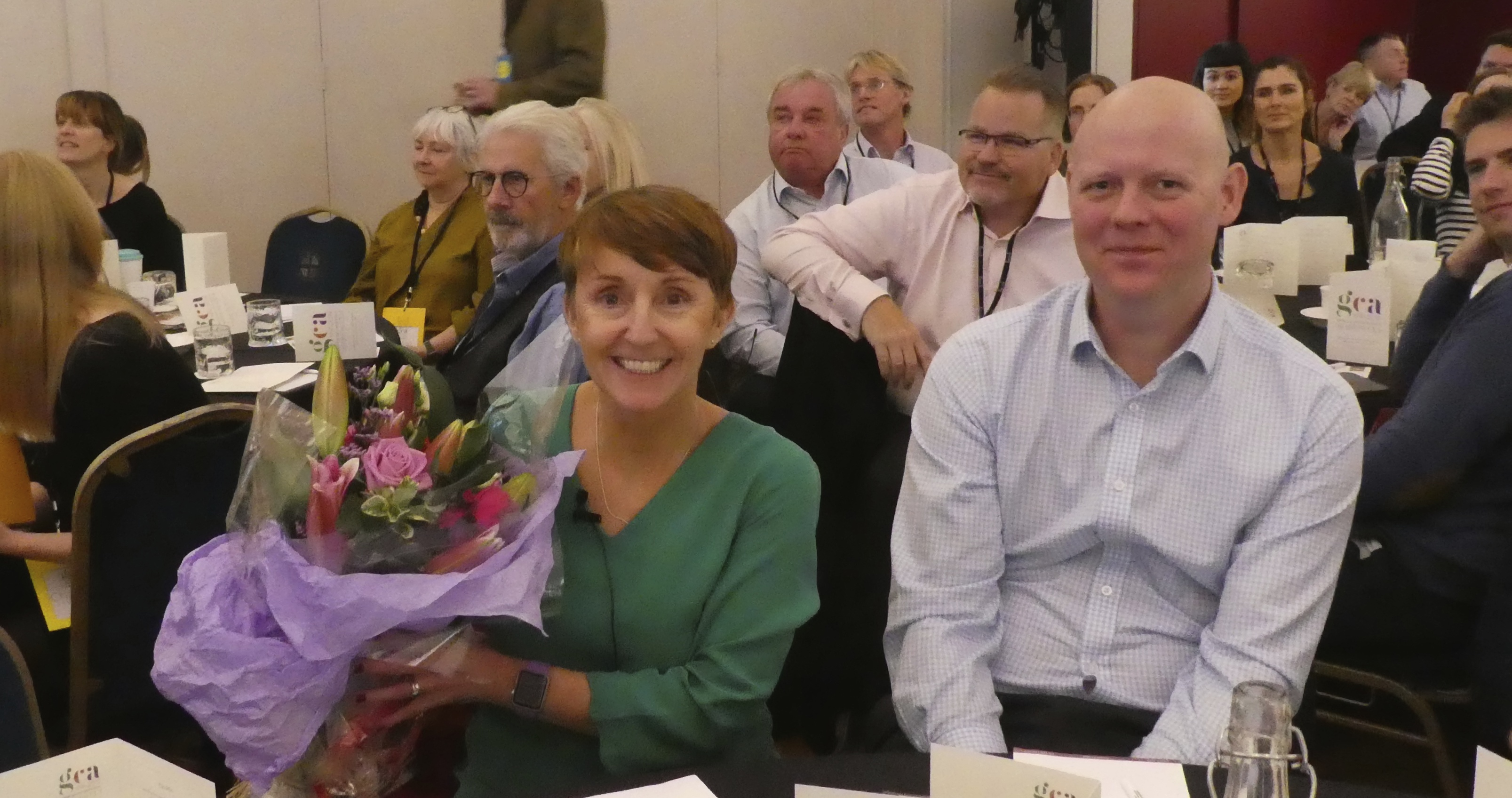 Above: Darren Cave (right) with co-director Ceri Stirland at the recent GCA AGM and Conference at which she was presented with a bouquet in recognition of her work at president. Darren has now joined the GCA Council.