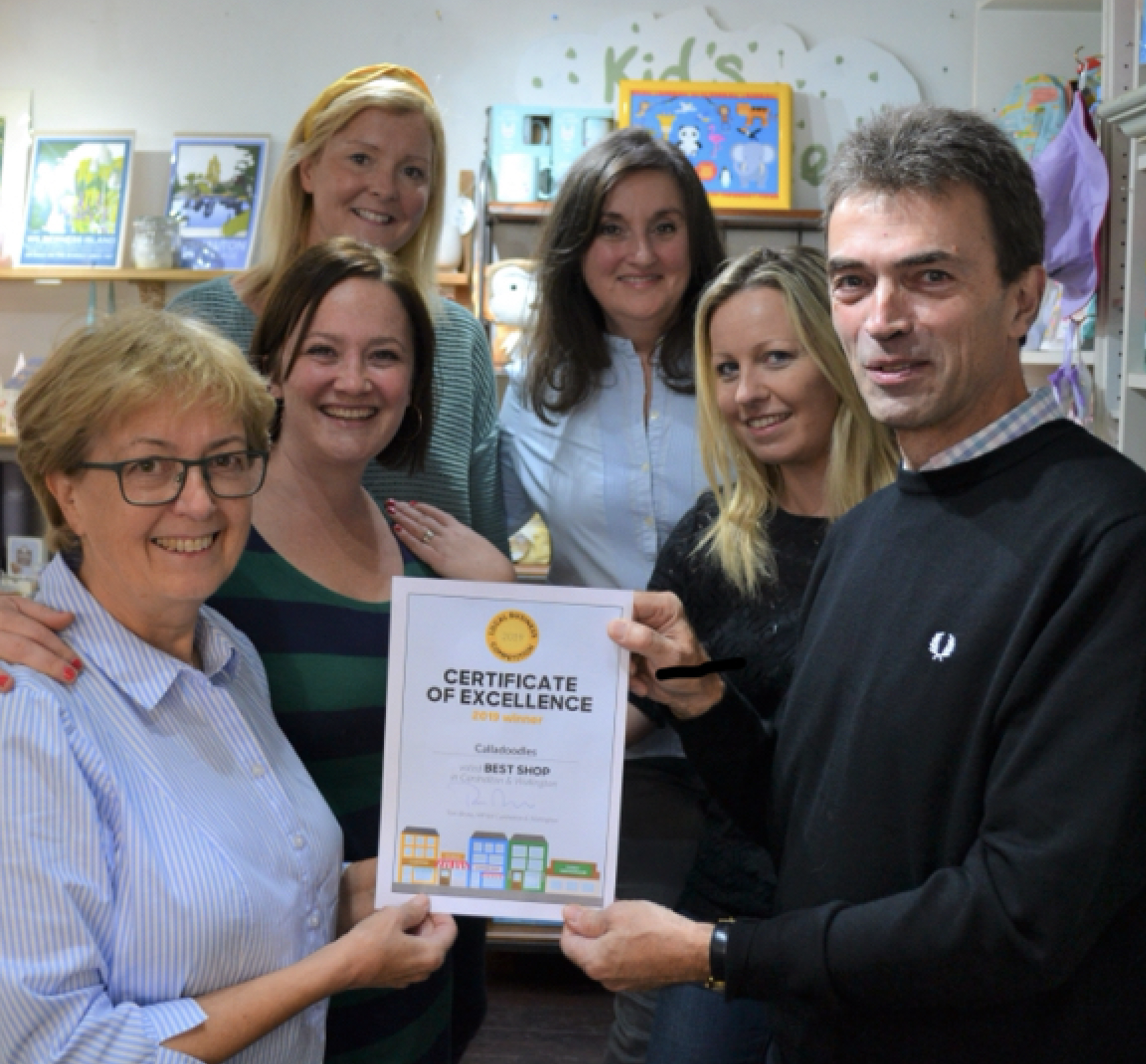Above: MP Tom Brake presenting Liz Killick (front left) and her Calladoodles team mates with their Certificate of Excellence.