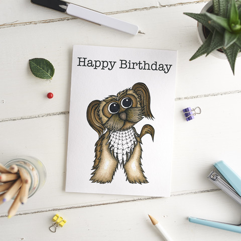 Above: Sarah Burman Design has a 'pack' of canines of different breeds on cards.
