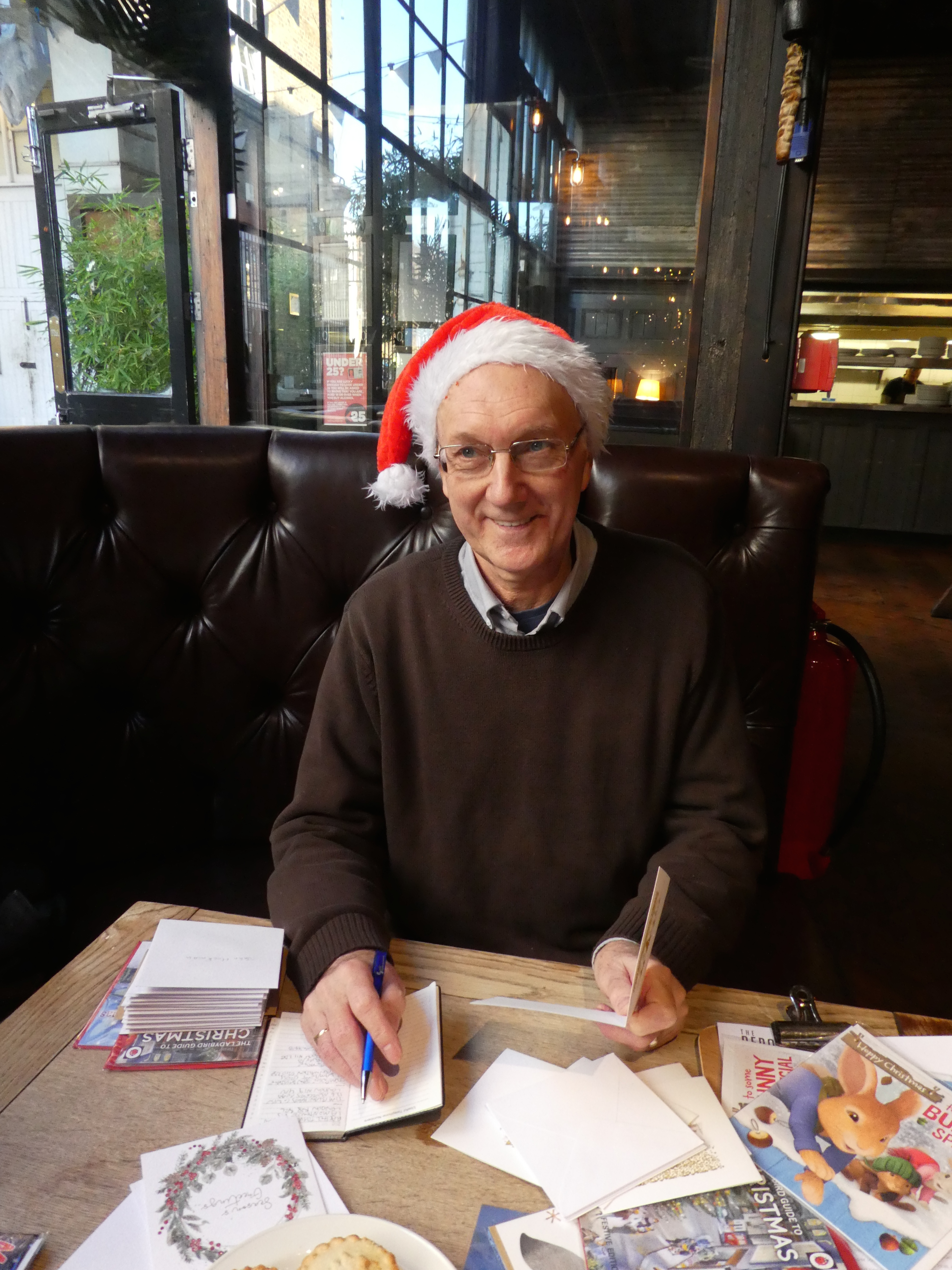 Above: Member of the public Nigel Scott was well up for Festive Friday, arriving with his address book with a mission to write and send all his Christmas cards at the GCA event.