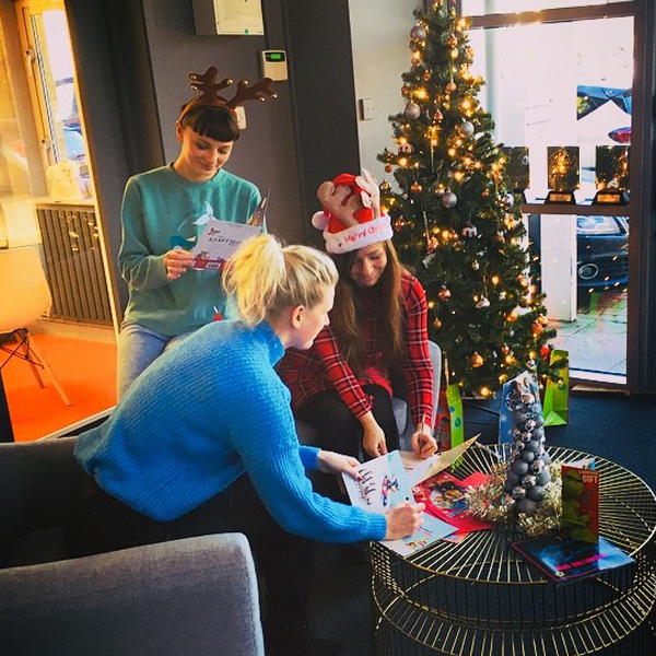Above: A trio of the Danilo team writing Christmas cards as part of the company's embrace of the event.