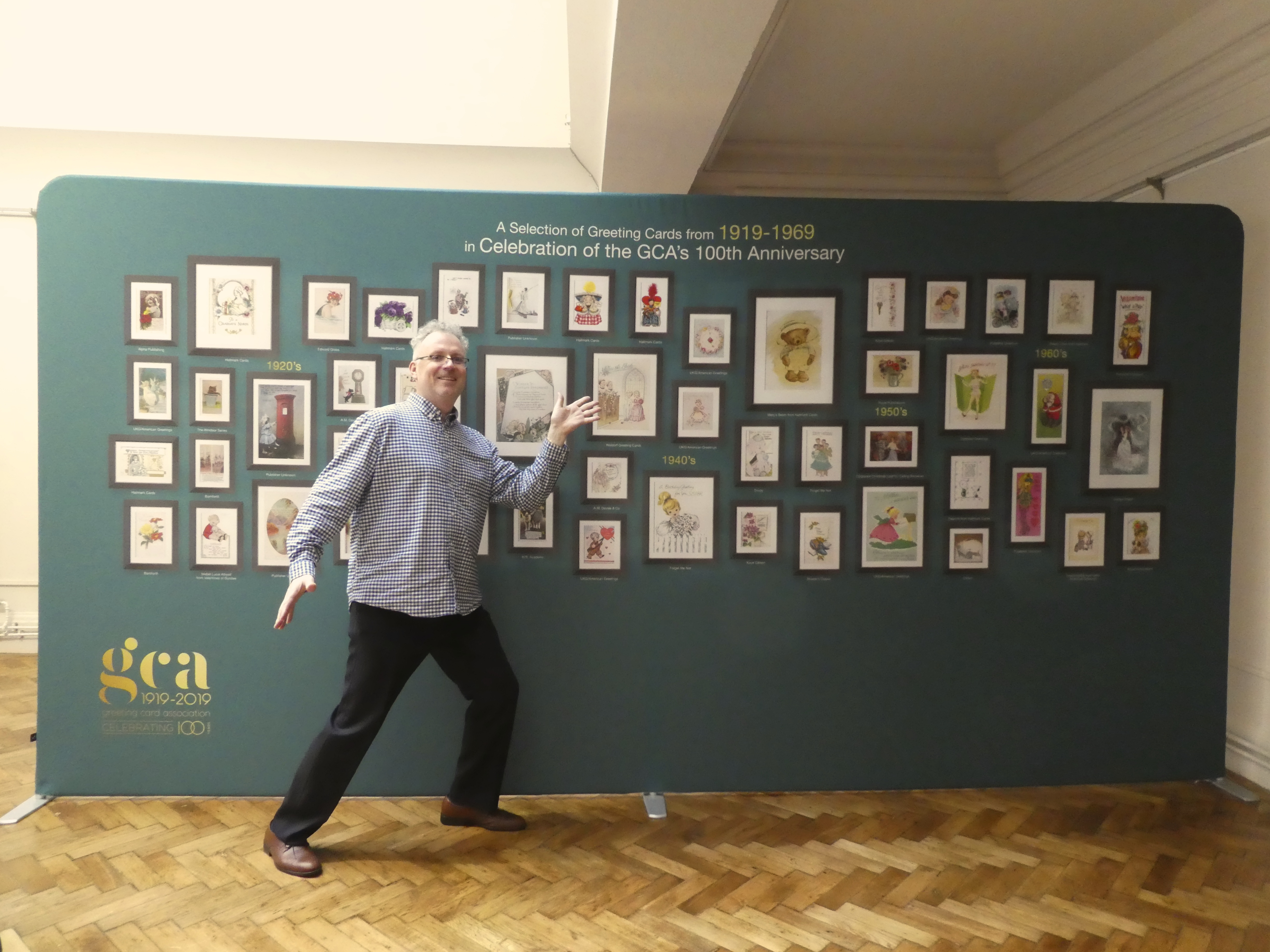 Above: Geoff Sanderson, curator of the exhibition in front of one of the panels.