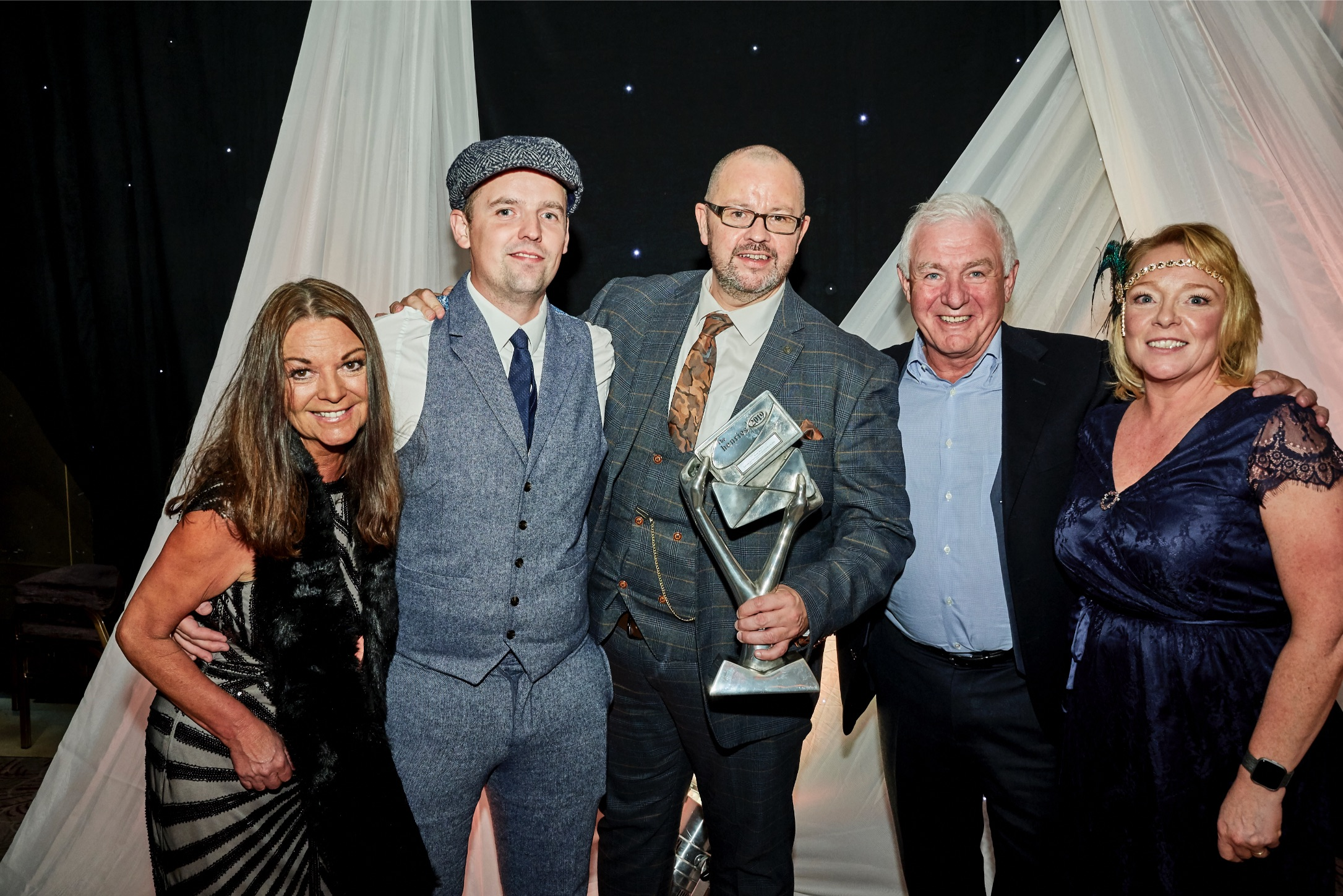 Above: In the Green Publishing/Out of the Blue Studios' co-owners Clive Rubin (second left) and Peter Rawlingson (centre) at The Henries last October (at which Out of the Blue won the Best Wholesale Range award) with colleagues (left-right) Bobbie Mulkerrin, Martin Sanderson and Colleen Whittaker.