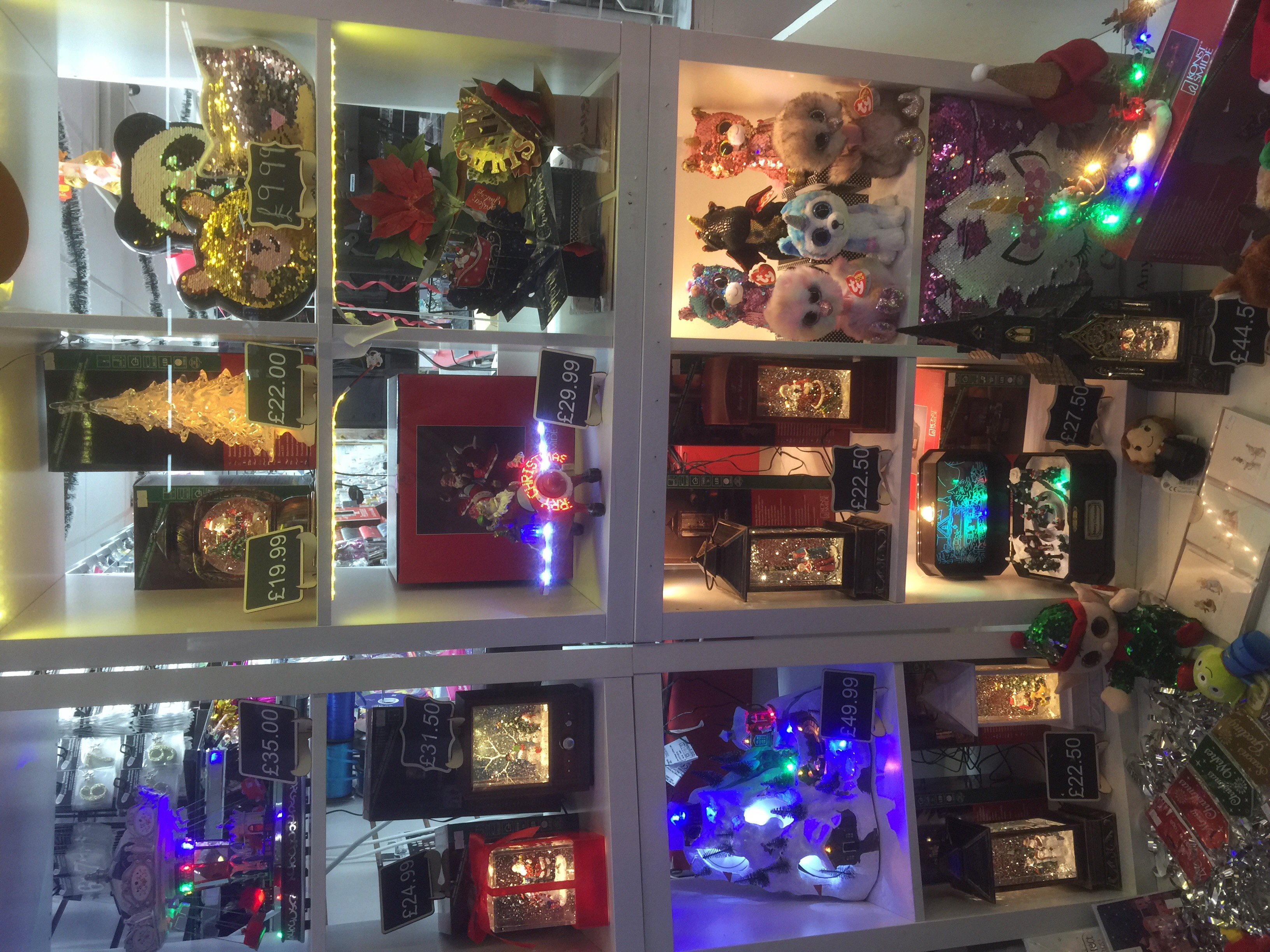 Above: An illuminated Christmas scene in Cards & Gifts.