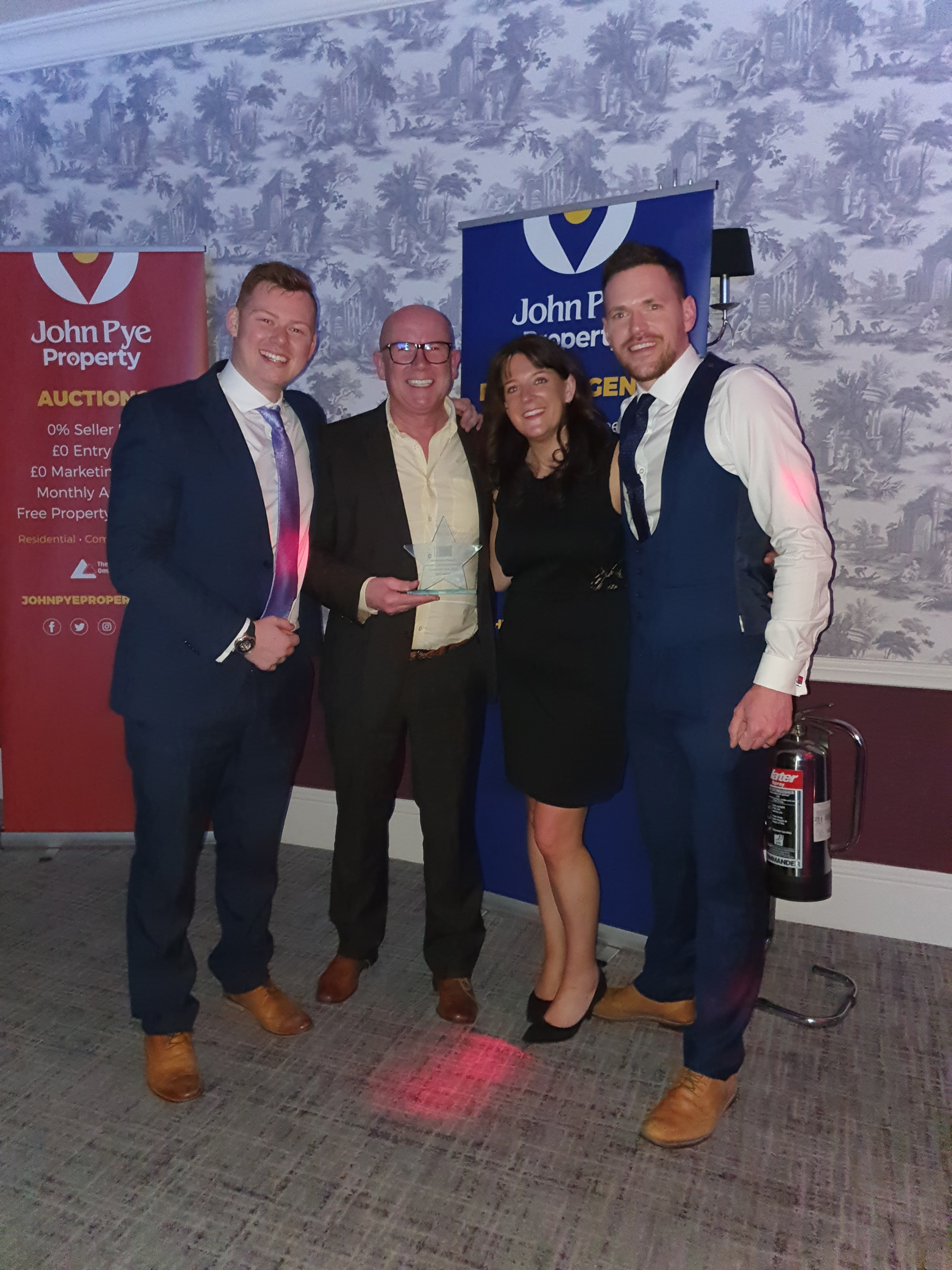Above: UKG's James McIntosh, Jonathan Glover, Demi Watson and Alex Forster were delighted to collect the award from JL&P.