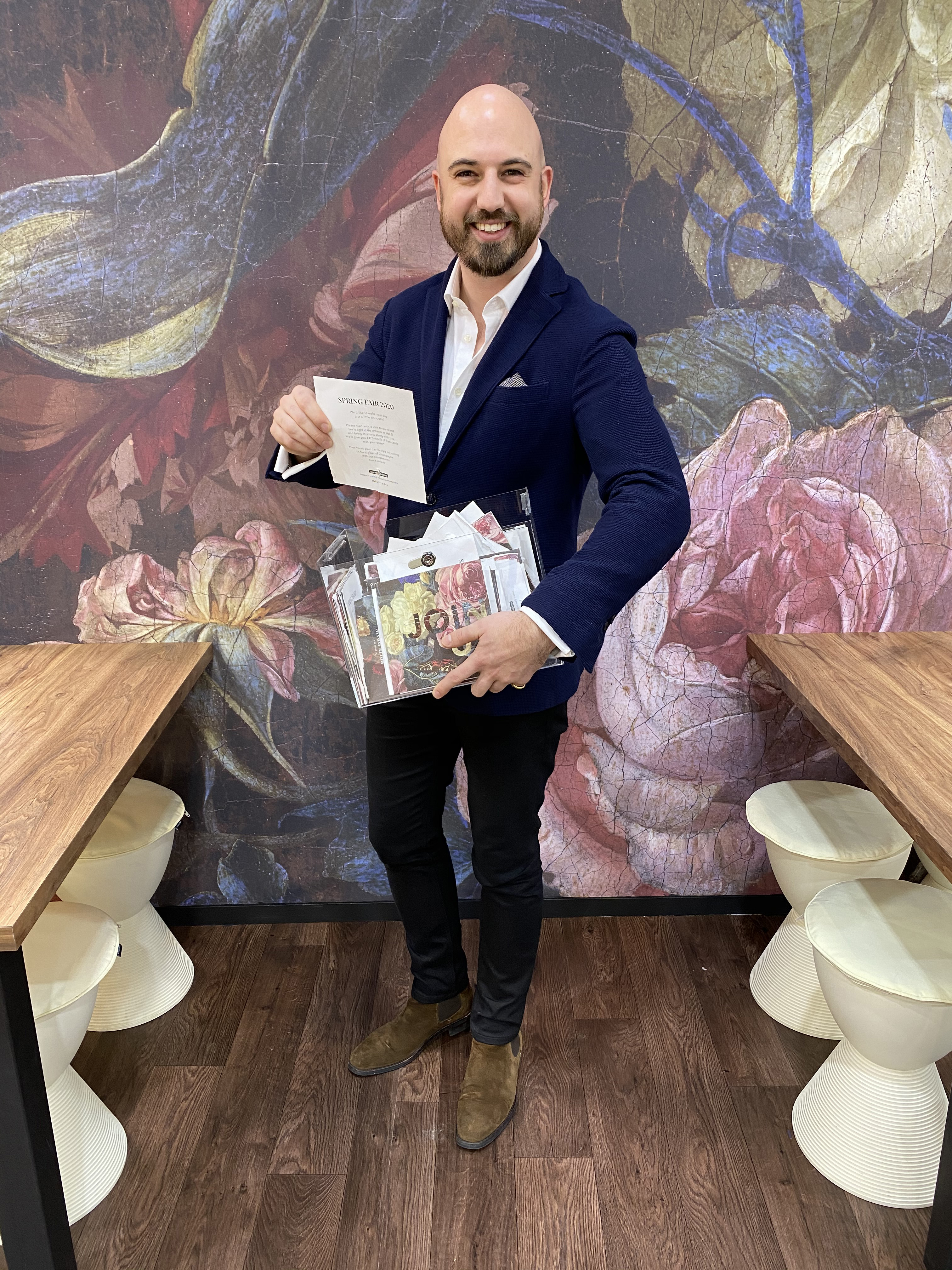 Above: Seth Woodmansterne, managing director incumbent of Woodmansterne Publications with a box full of entries to its Spring Fair prize draw.