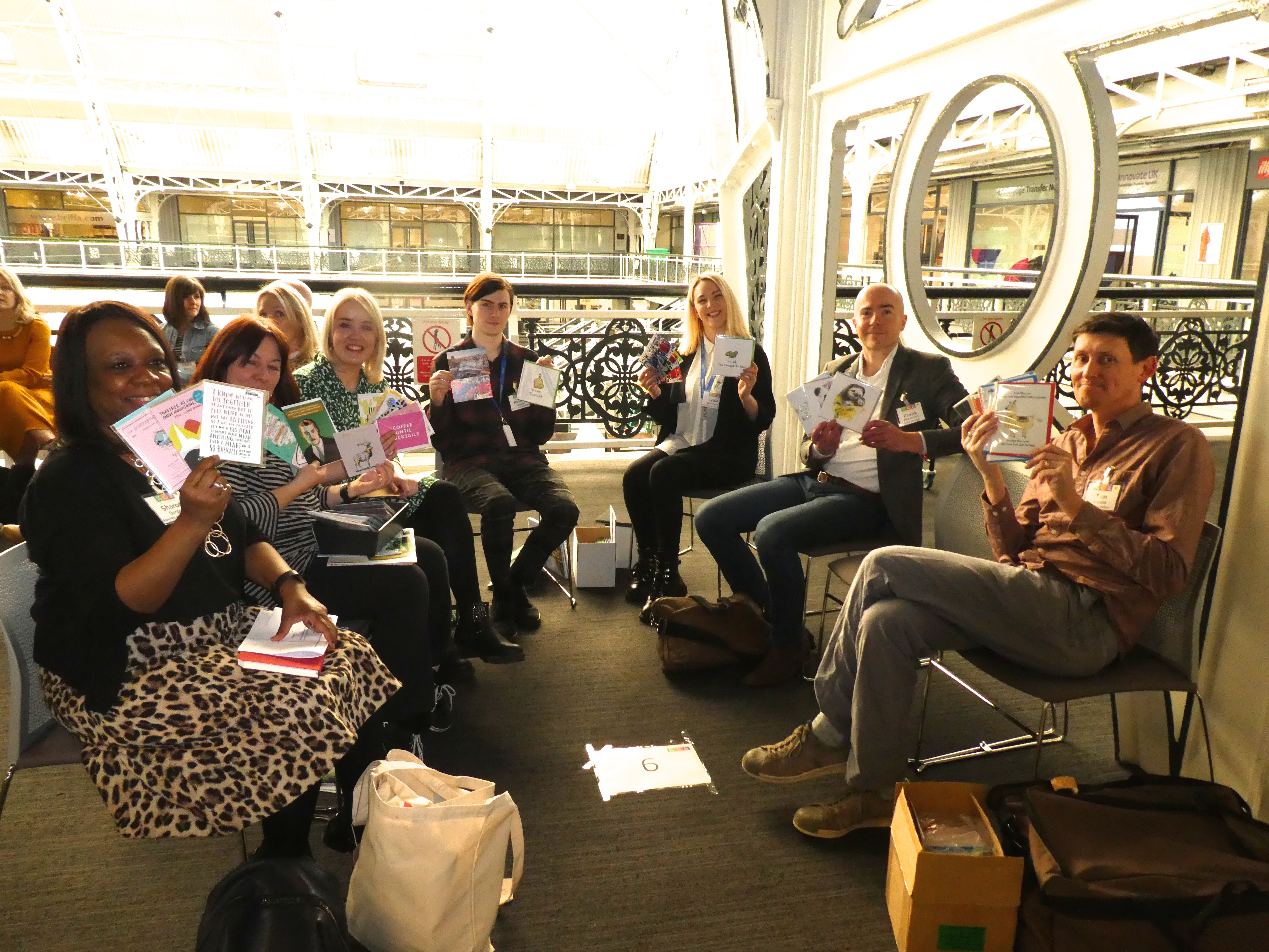 Above: Just prior to pitching, publishers hold up their cards to make the 'dragons' selection easier.