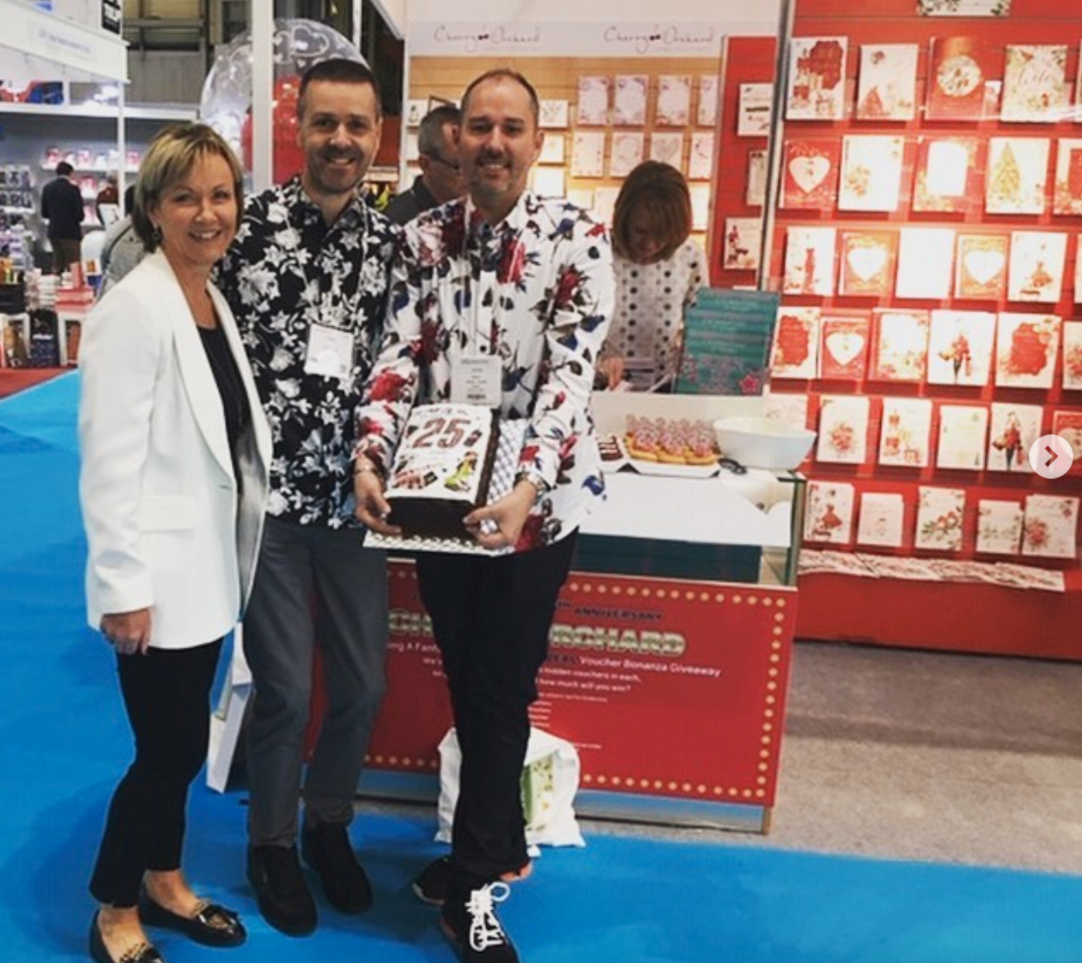 Above: Jackie Collins, md and owner of Cherry Orchard Publishing with a 25thanniversary cake that she was presented with Carl Dunne (centre) and Oliver Guise-Smith of Cards & Gifts, Sheffield at the recent Spring Fair.