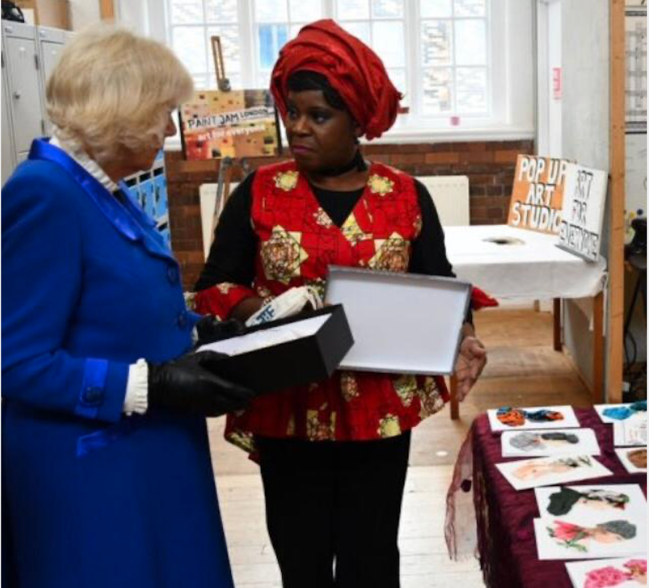 Above: Dayo Williams discusses her greeting cards with Camilla, The Duchess of Cornwall.