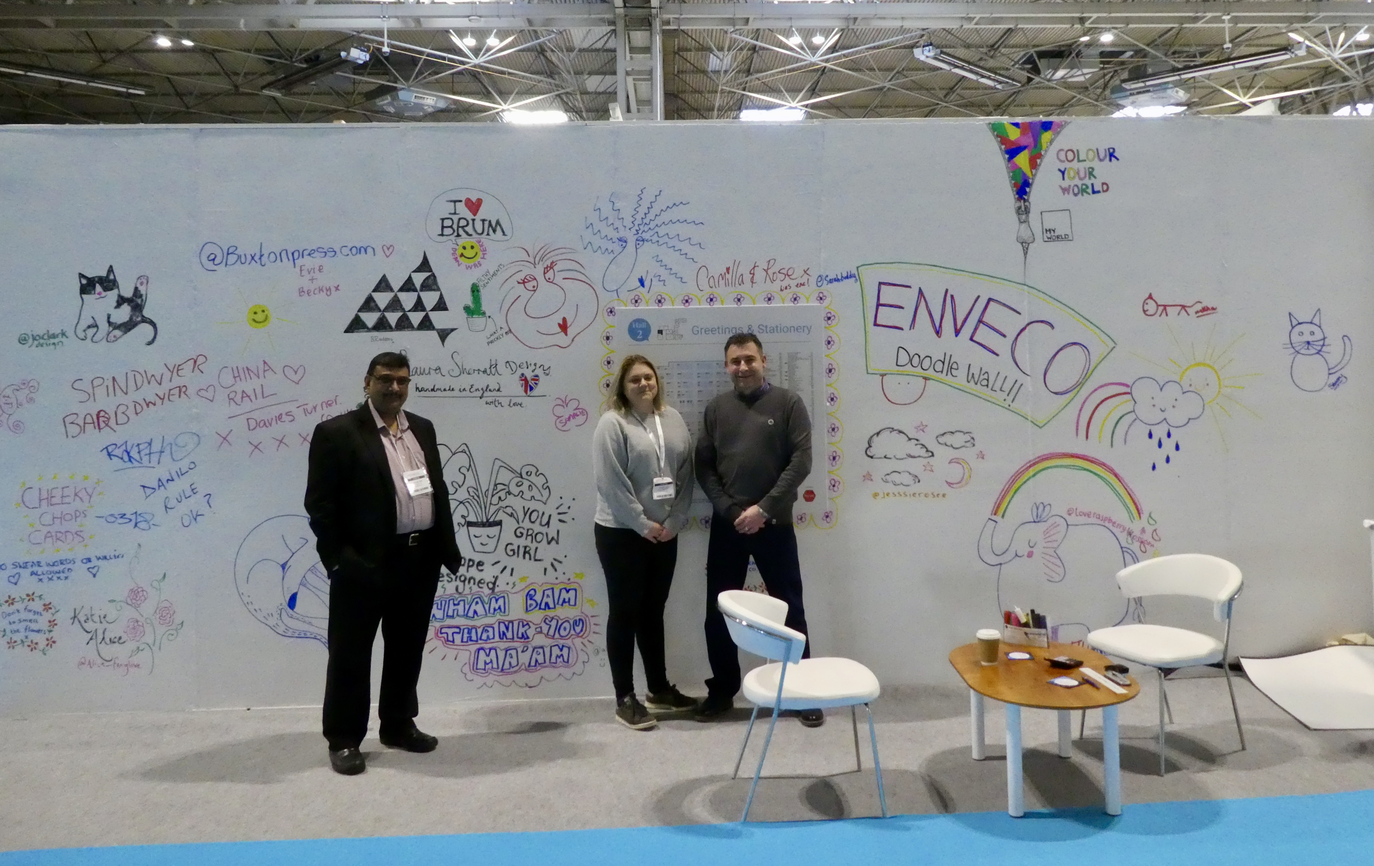Above: Enveco made the most of the 'blank canvas' next to its stand, encouraging publisher's to be creative. (Left-right) Enveco's owner Piyush Shah, office manager Stacey Lee and sales director John Jones.