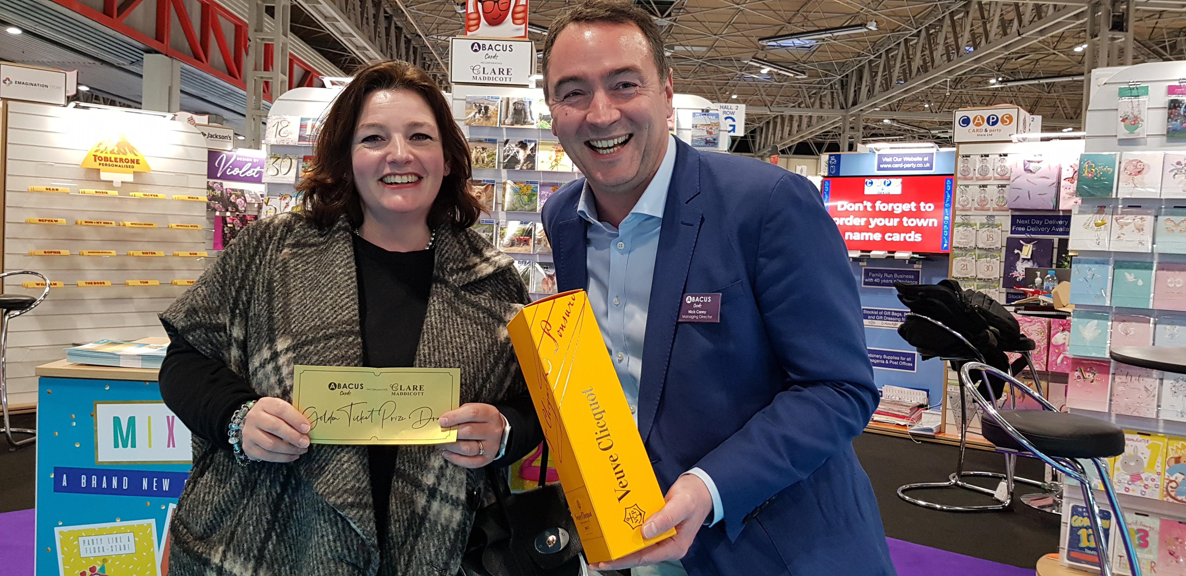 Above: Sophie Timmermans of Timmermans Garden Centre was the Wednesday winner of the Abacus Golden Ticket prize draw, which saw managing director Nick Carey present her with a bottle of champagne.