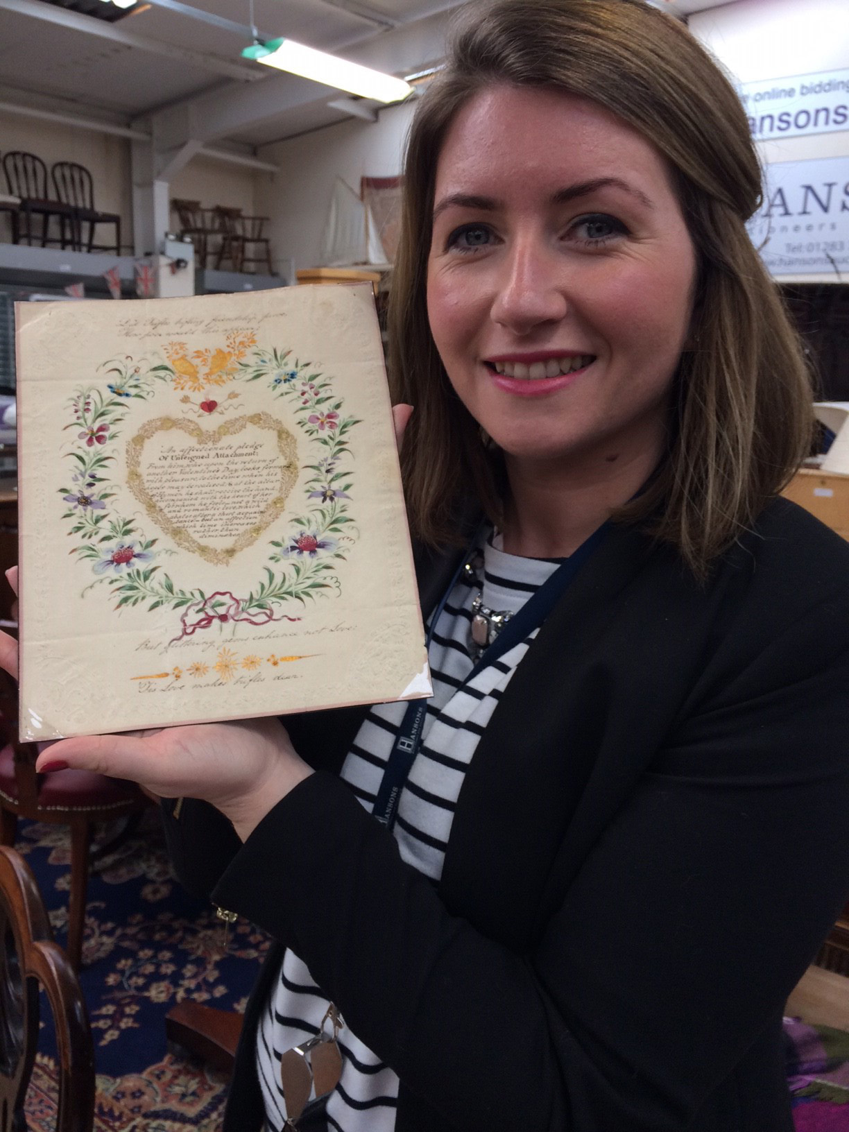 Above: Hansons' valuer Isabel Murtough holds the Valentine that comes up for auction this Friday (14 February).