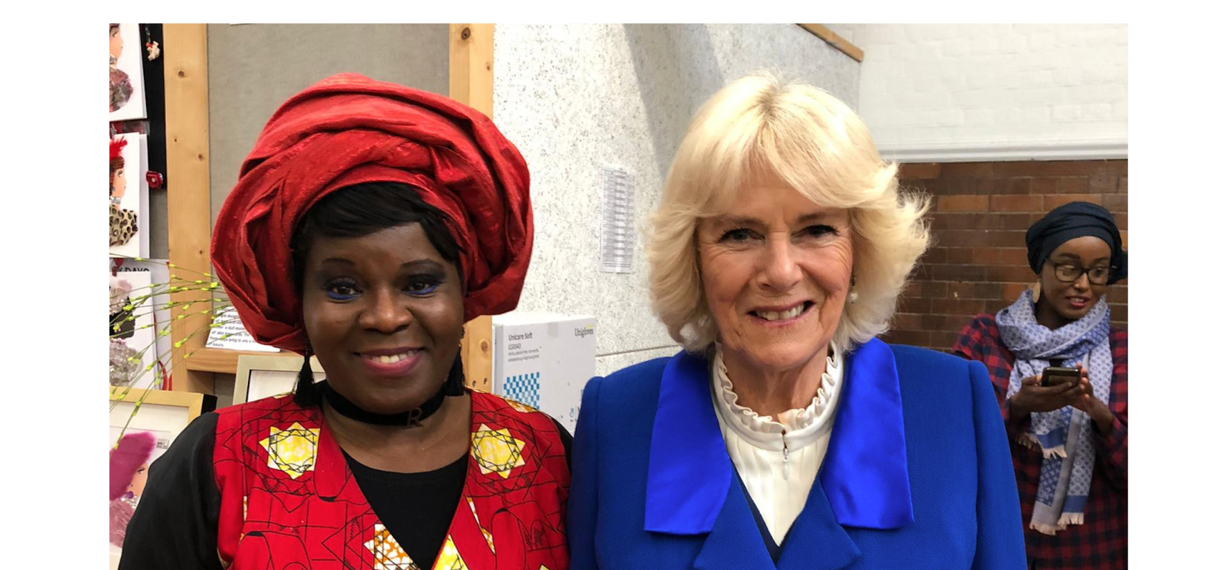 Above: Dayo Williams (left), founder of Dayo's Cards with The Duchess of Cornwall.